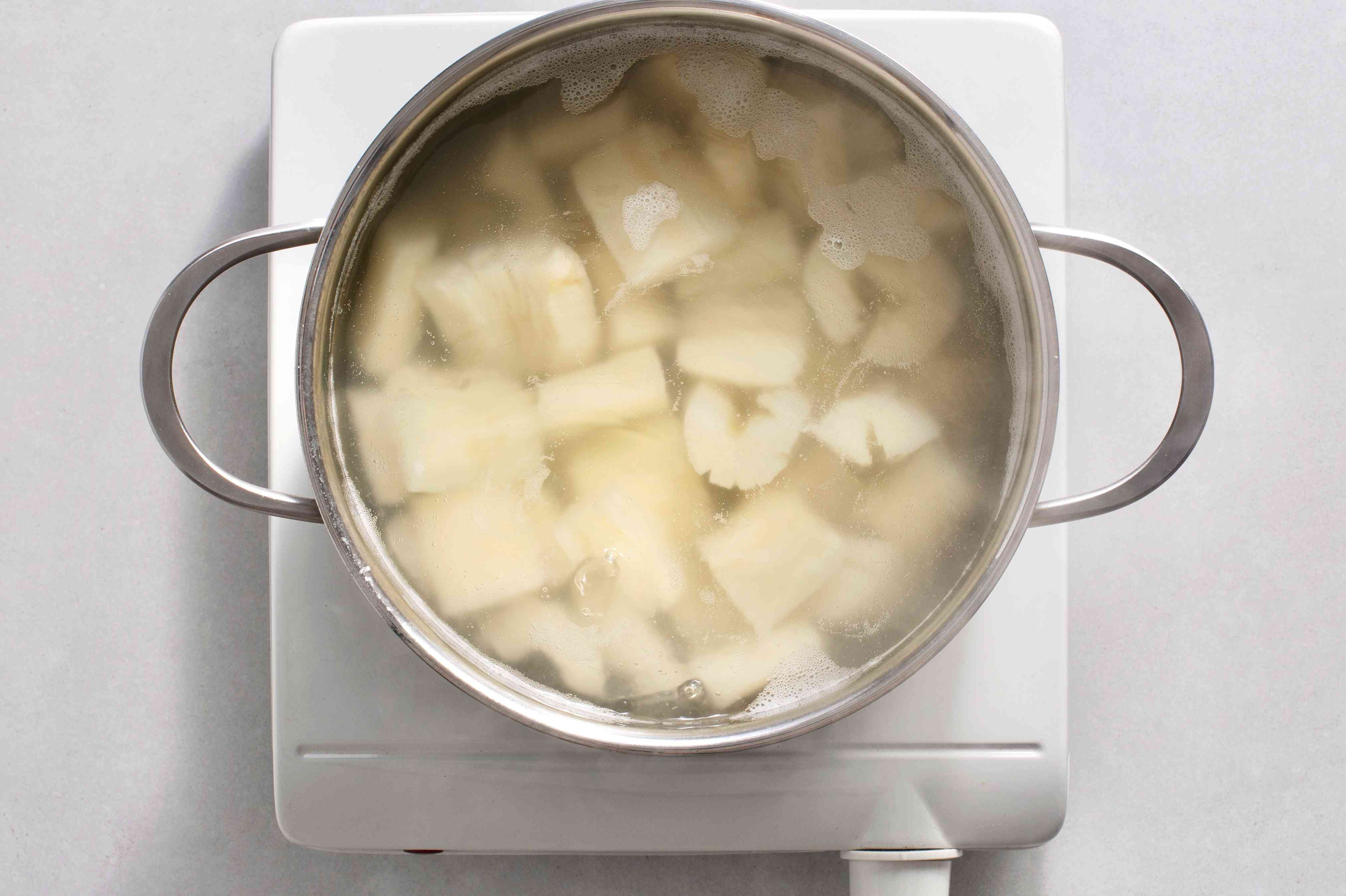 Boil the yuca in salted water