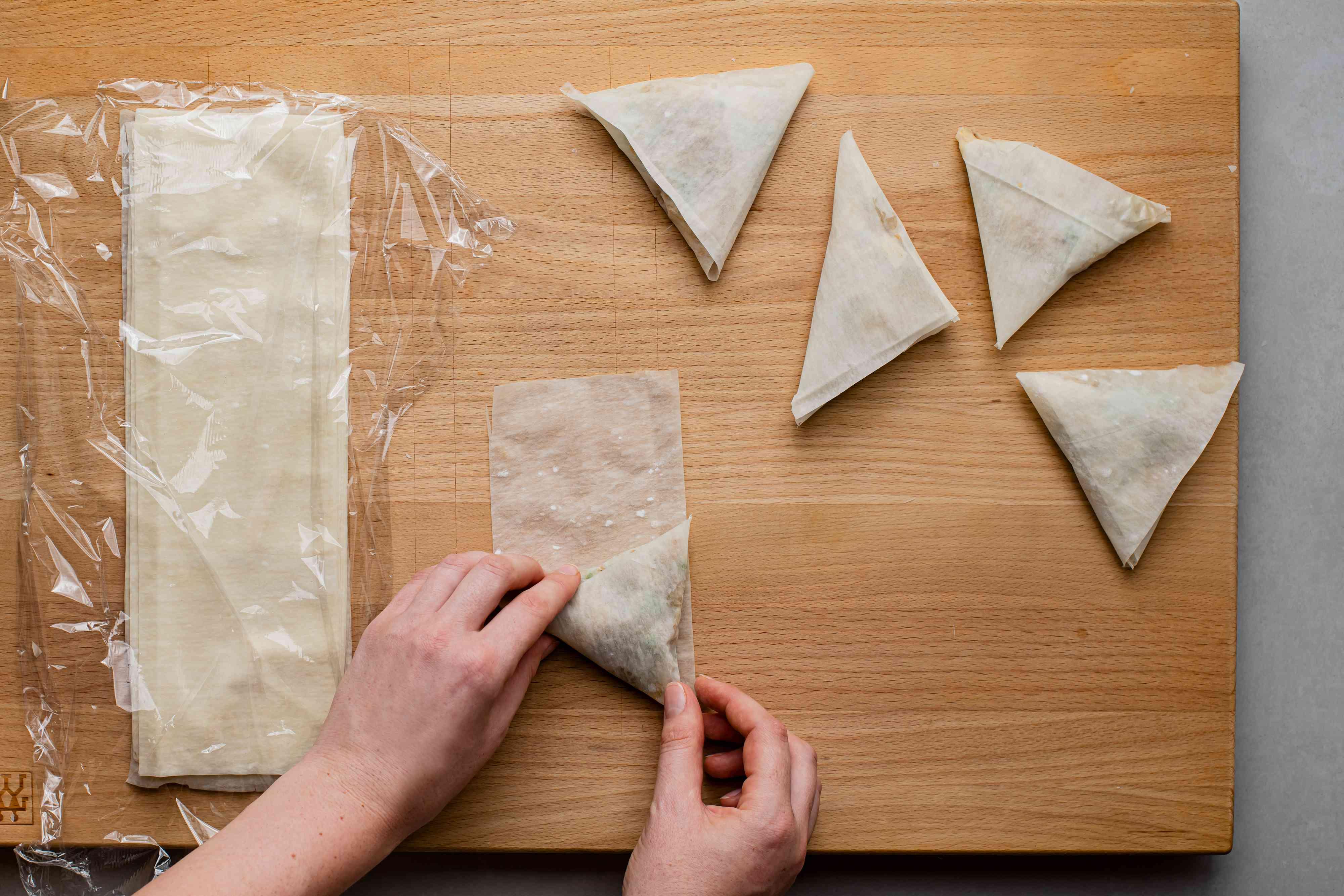 wrap the phyllo dough around potato and pea mixture