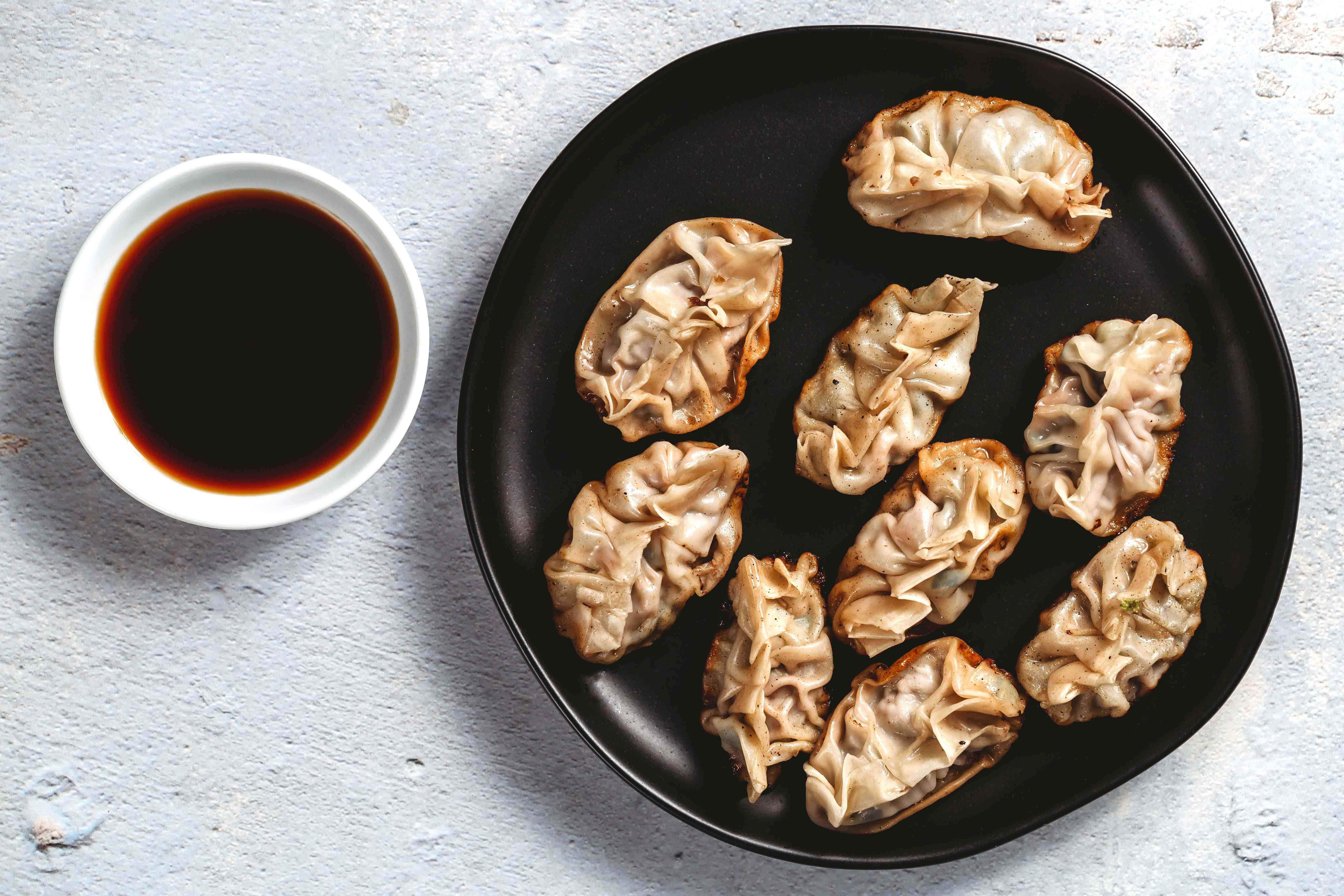 Dumplings served with dipping sauce