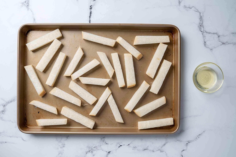 Spread out jicama on a baking sheet