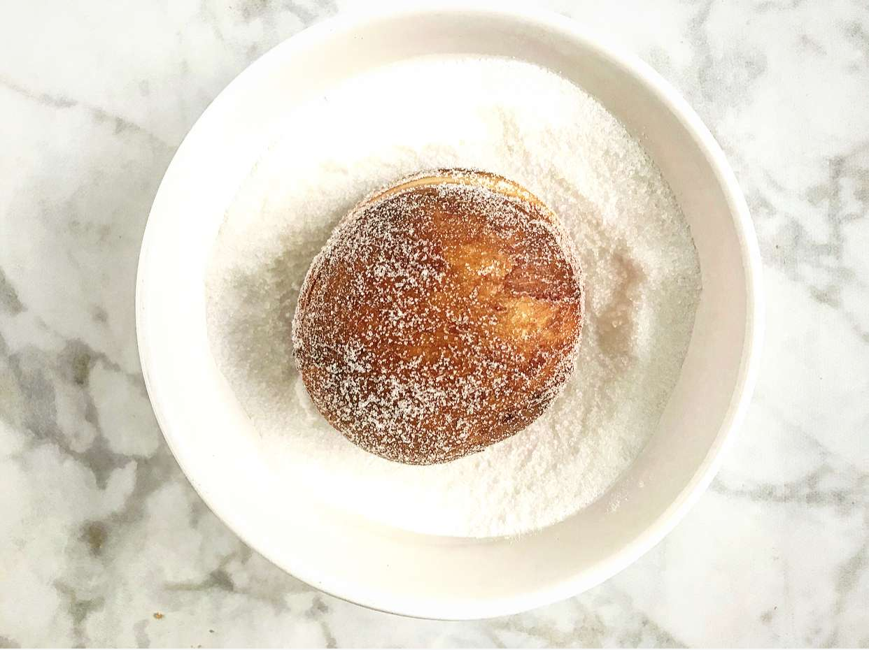 Toss donuts in sugar