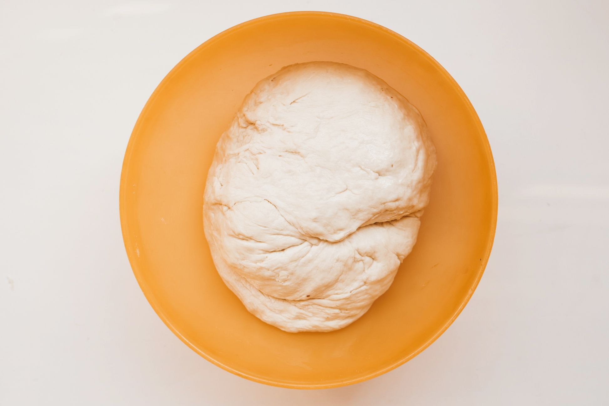 Place dough in greased bowl