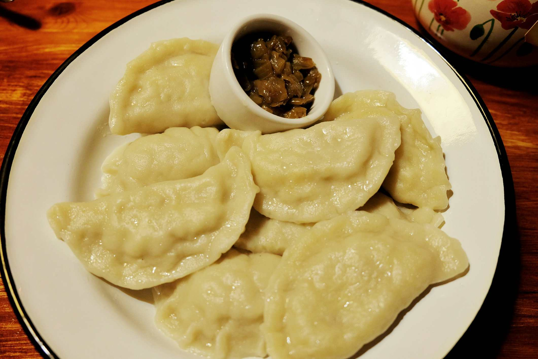 High Angle View Of Pierogi Served In Plate On Wooden Table