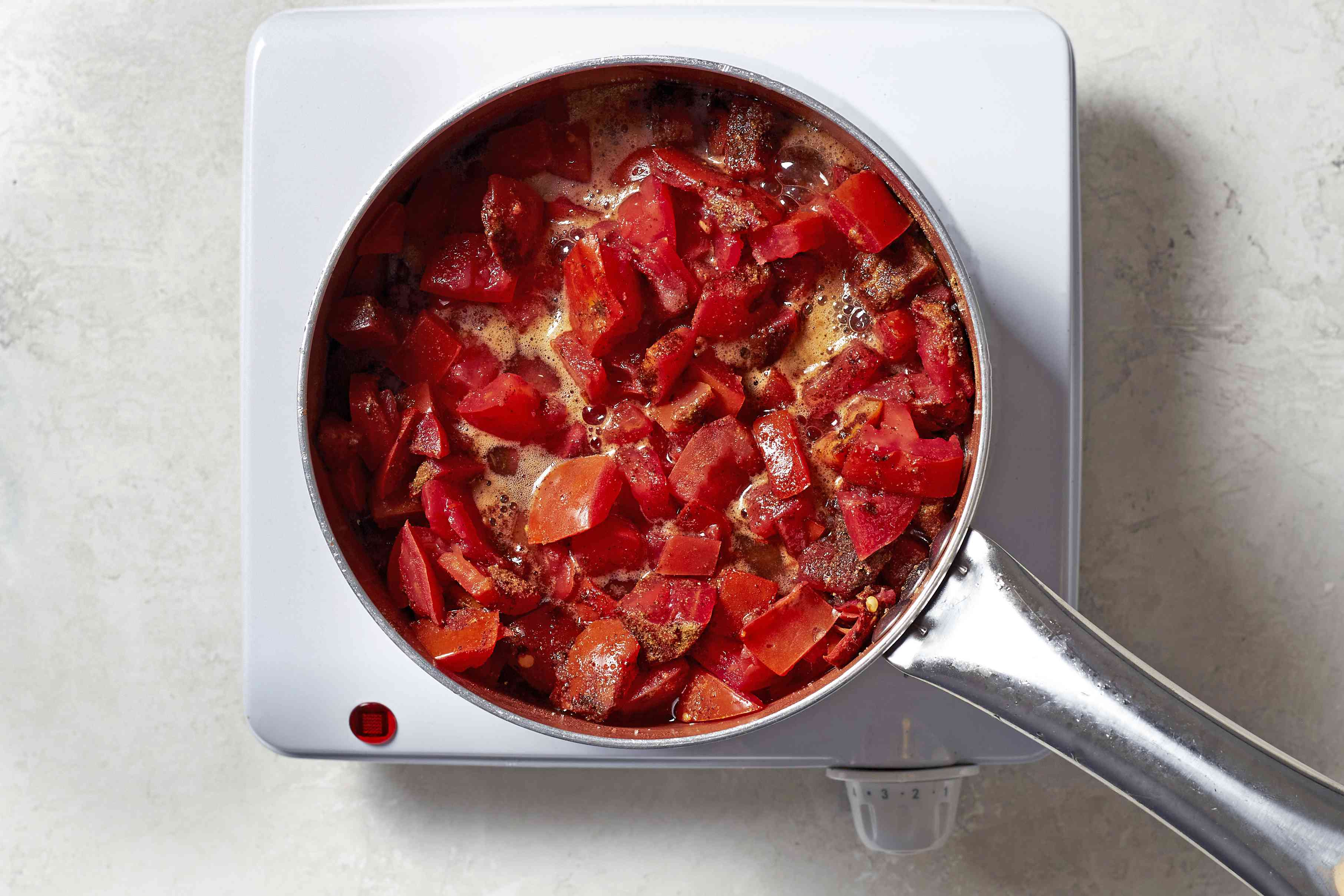 Combine the tomatoes, spices, sugar, pepper flakes, and lemon juice in a saucepan