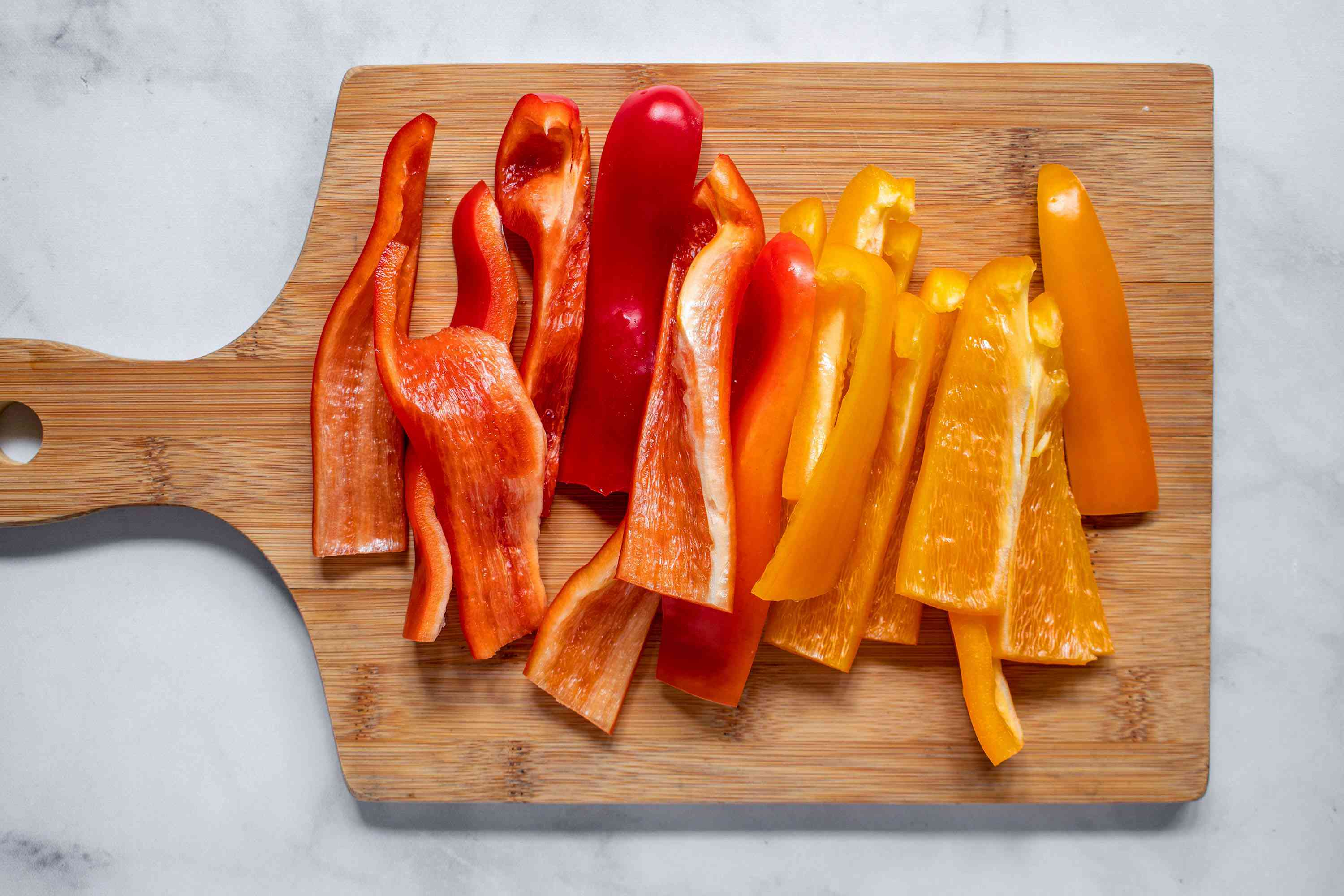 Cut the peppers lengthwise into 1/2-inch slices