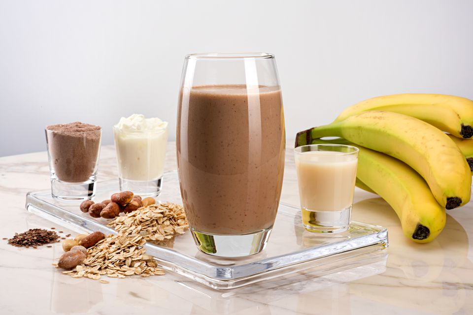 Chocolate smoothie and ingredients on counter