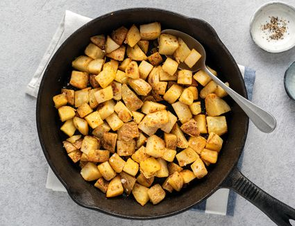Country Fried Potatoes in a cast iron skillet