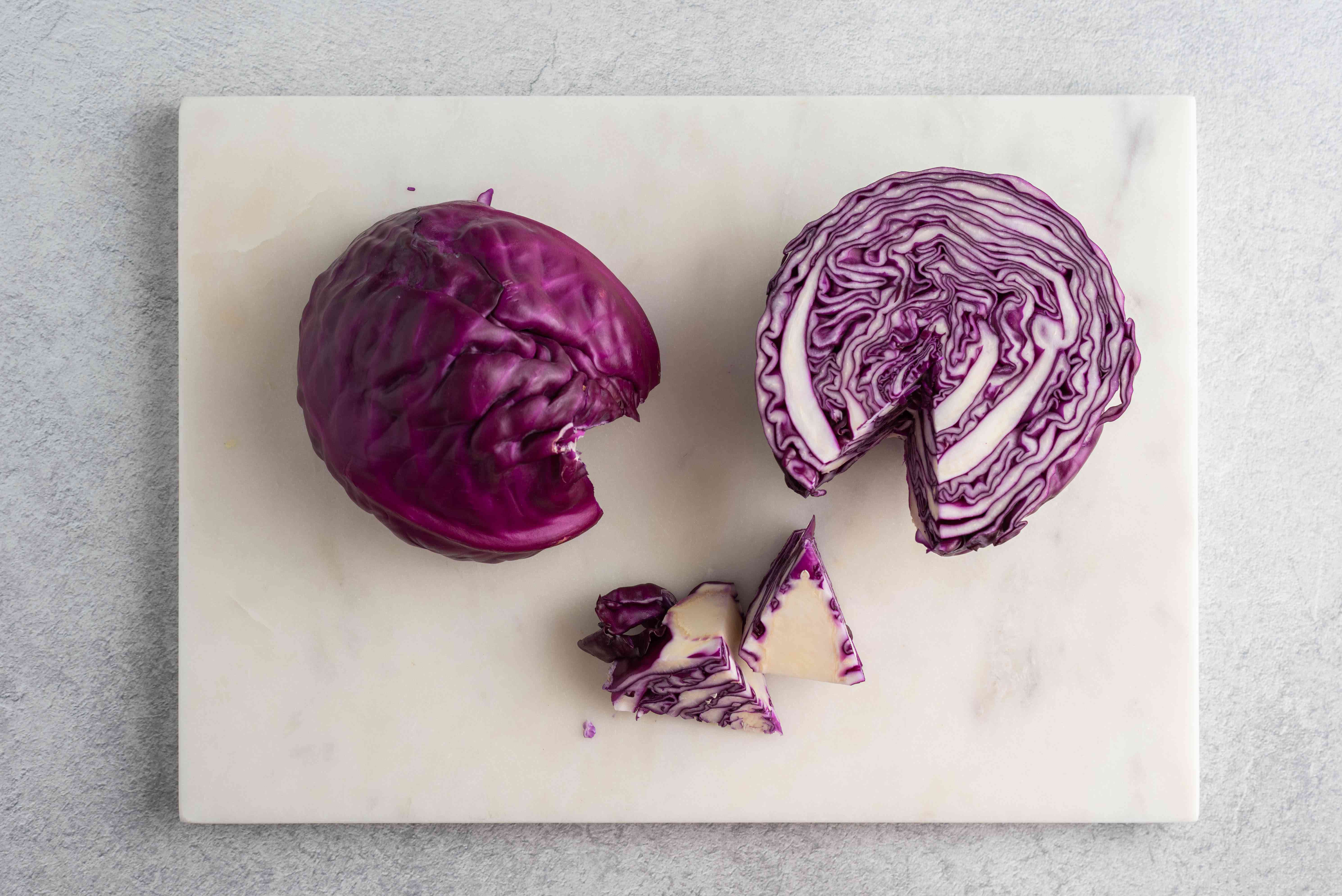 red cabbage with the core and stem removed on a cutting board