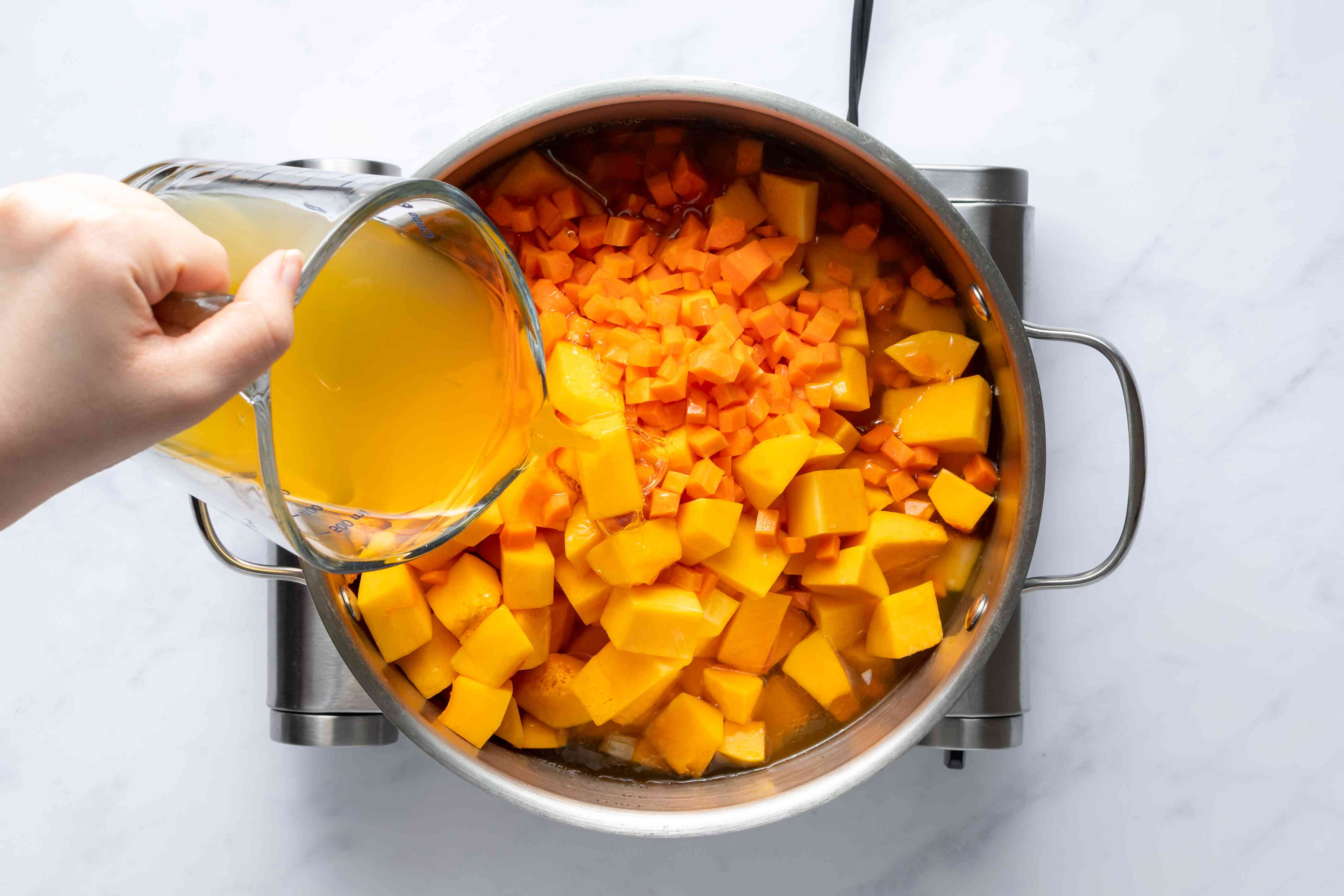 Add butternut squash and vegetable stock to pot