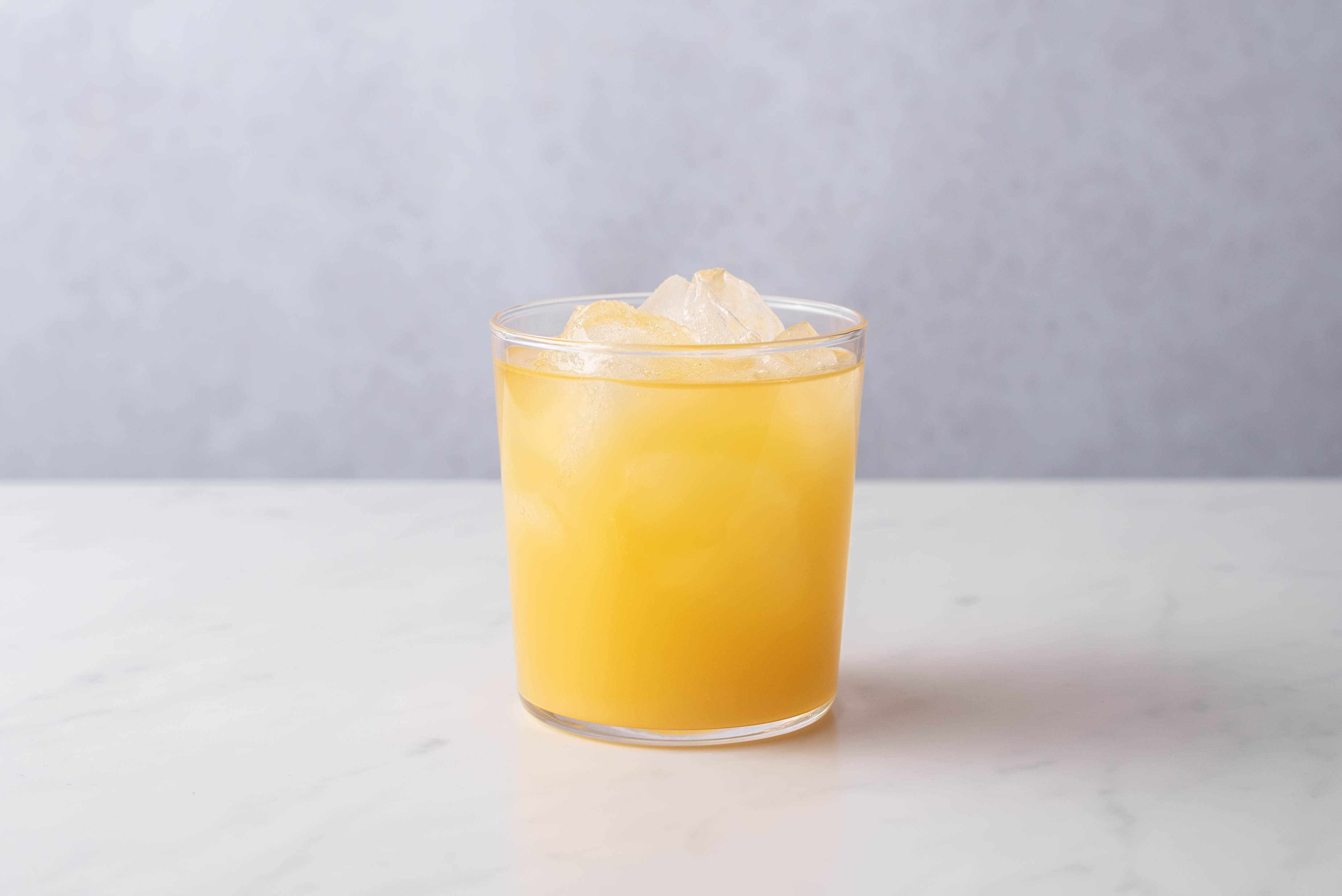 add pineapple juice to the cocktail in the glass