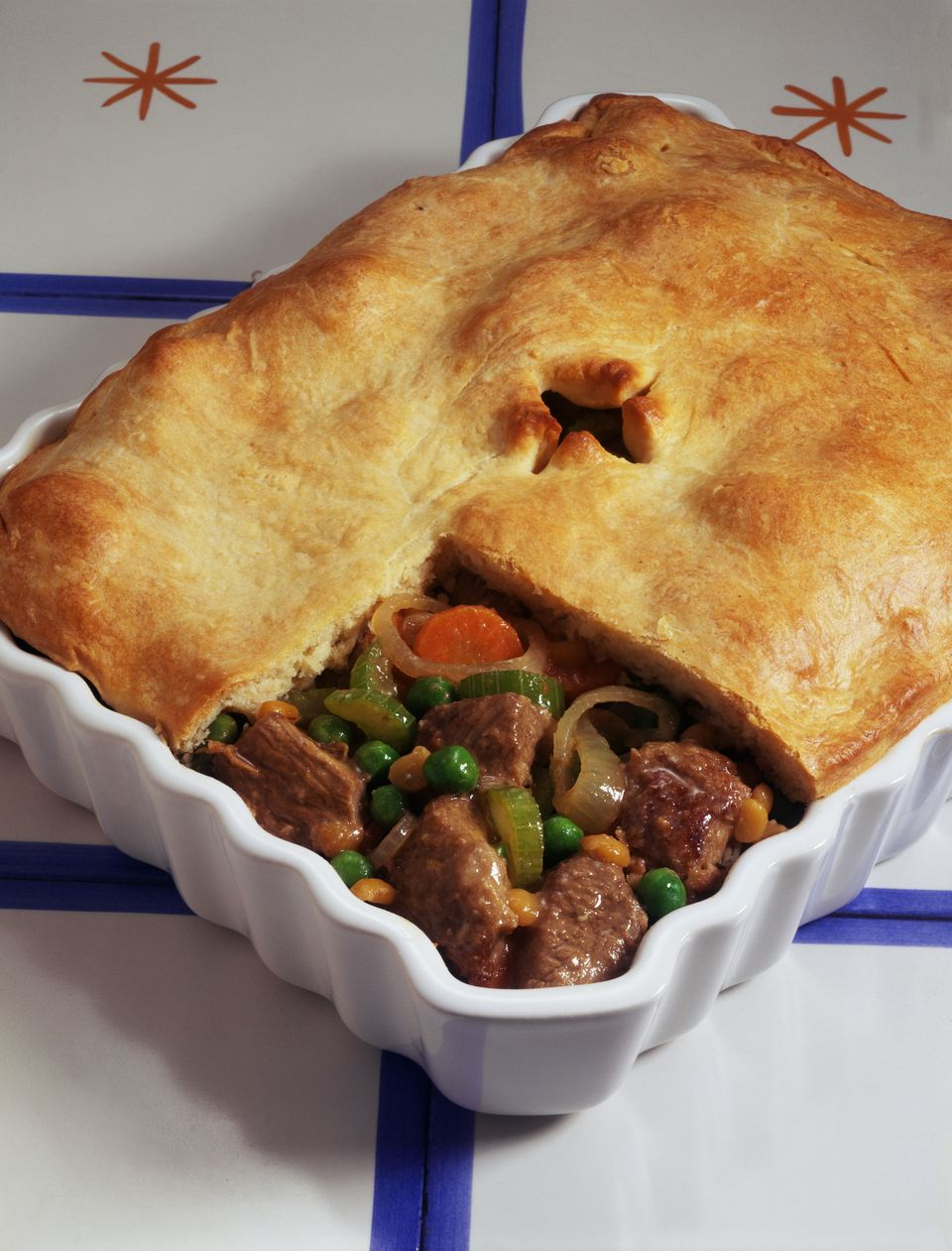 Meat pot pie in a casserole dish on a tile counter