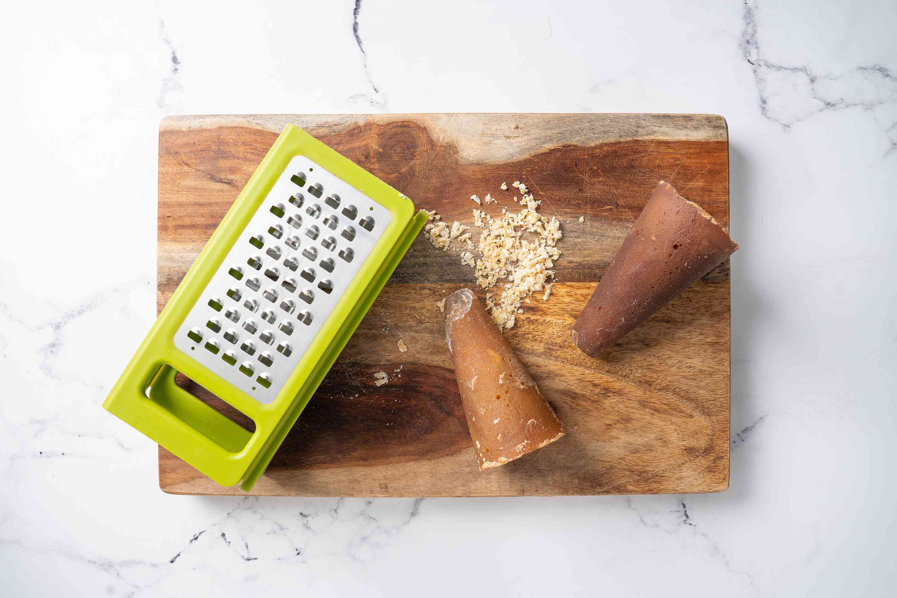 Piloncillo grated on a cutting board