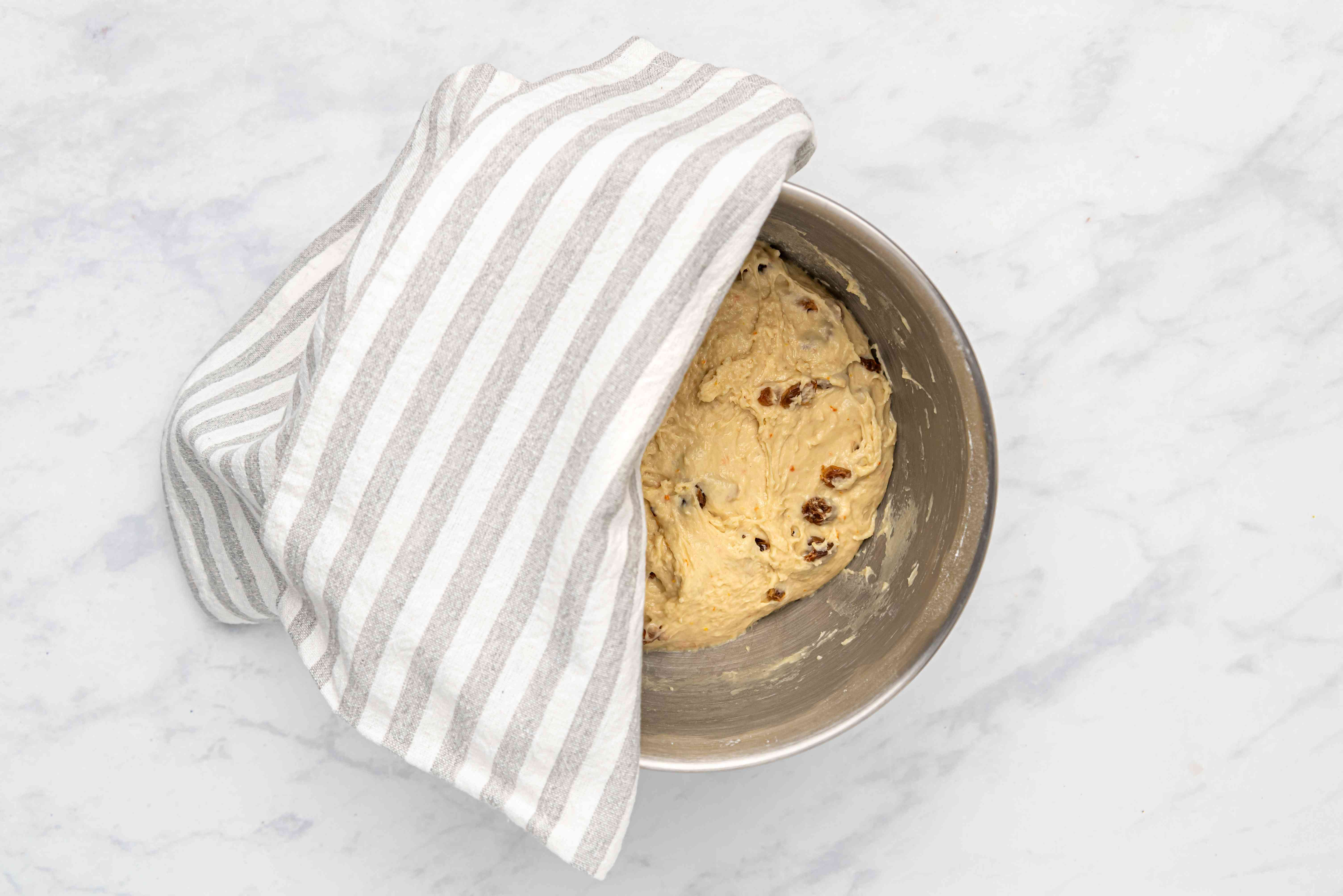 cover dough in the bowl with a towel