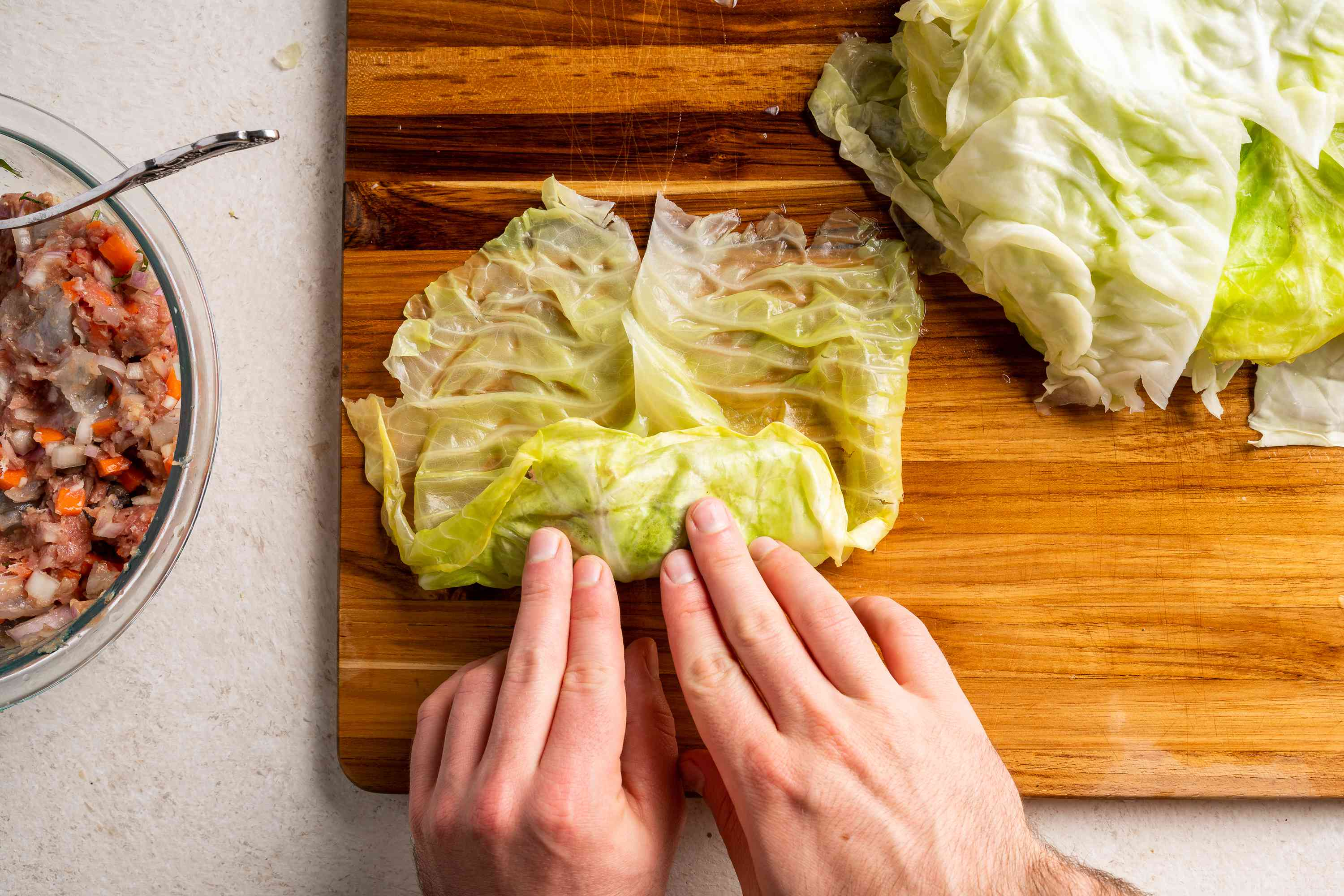 Take the cabbage edge nearest you, fold over the filling