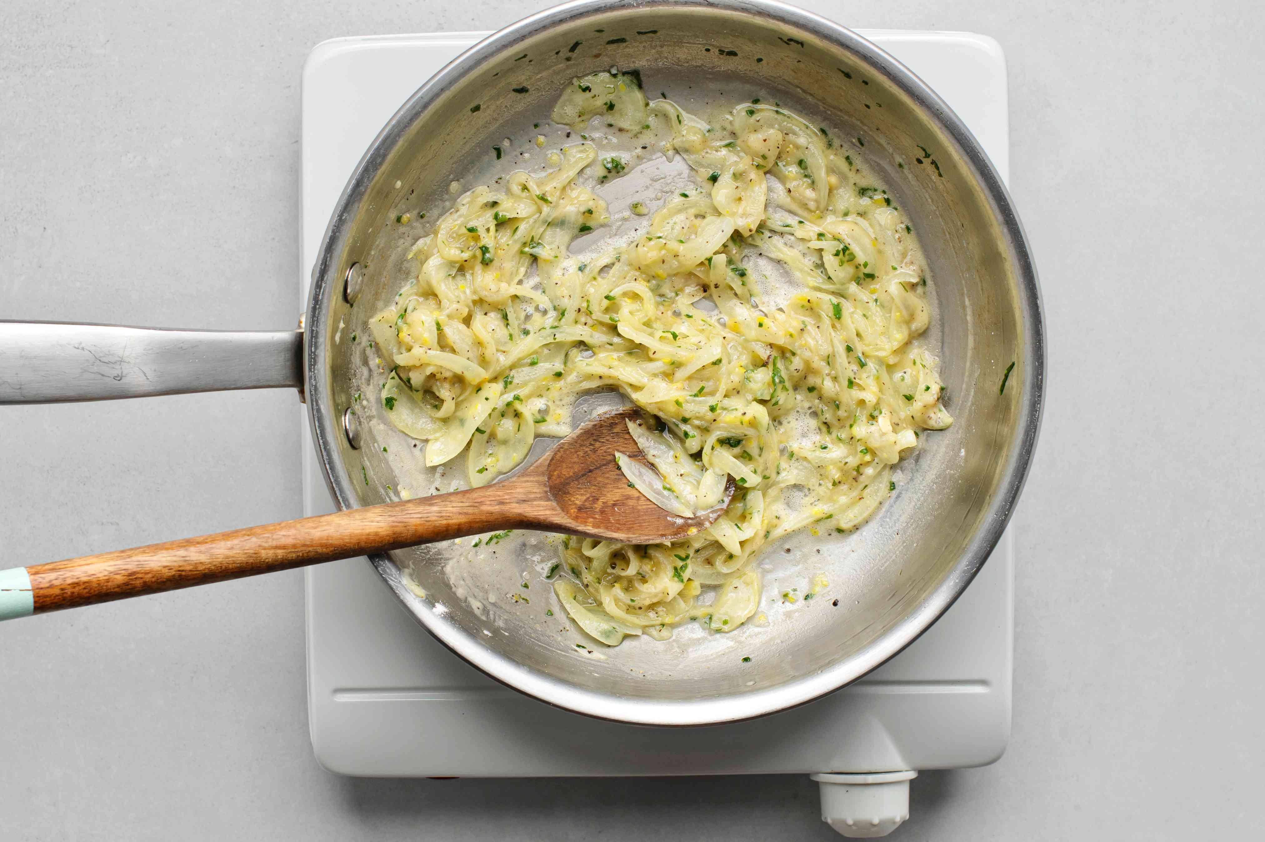 Blend the flour, lemon zest, salt, and pepper into the onion mixture