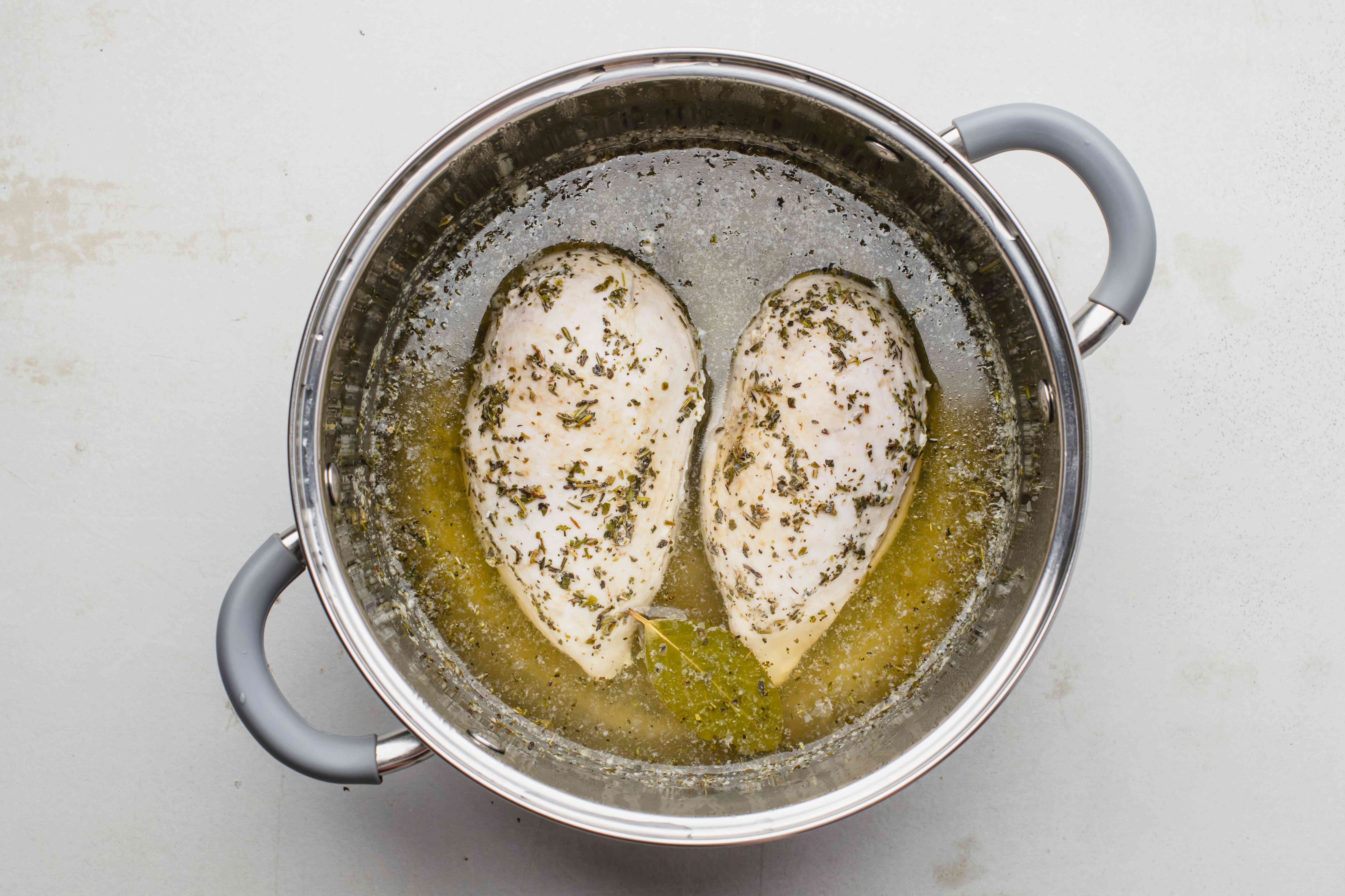 Turn off heat and let poaching chicken rest