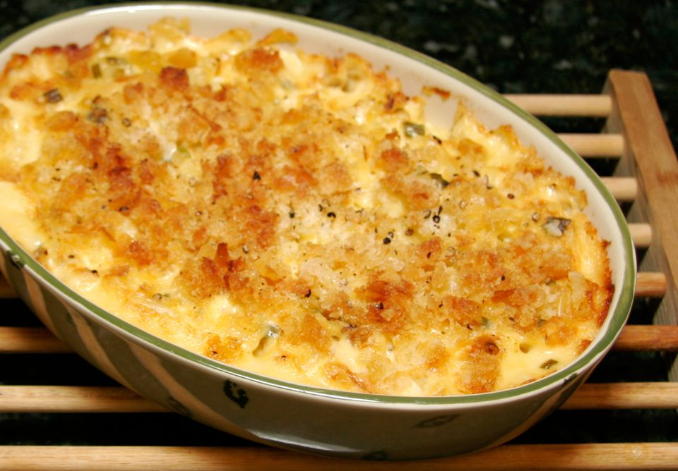 Hash Brown Casserole in a White-and-Green Casserole Dish on a wooden rack