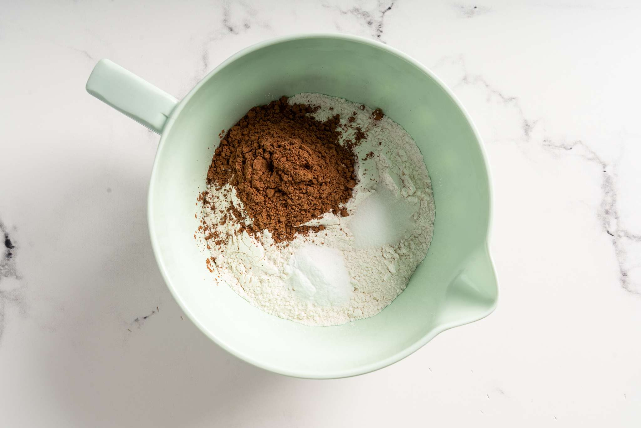 Dry ingredients for Blue Velvet Cake in a mixing bowl