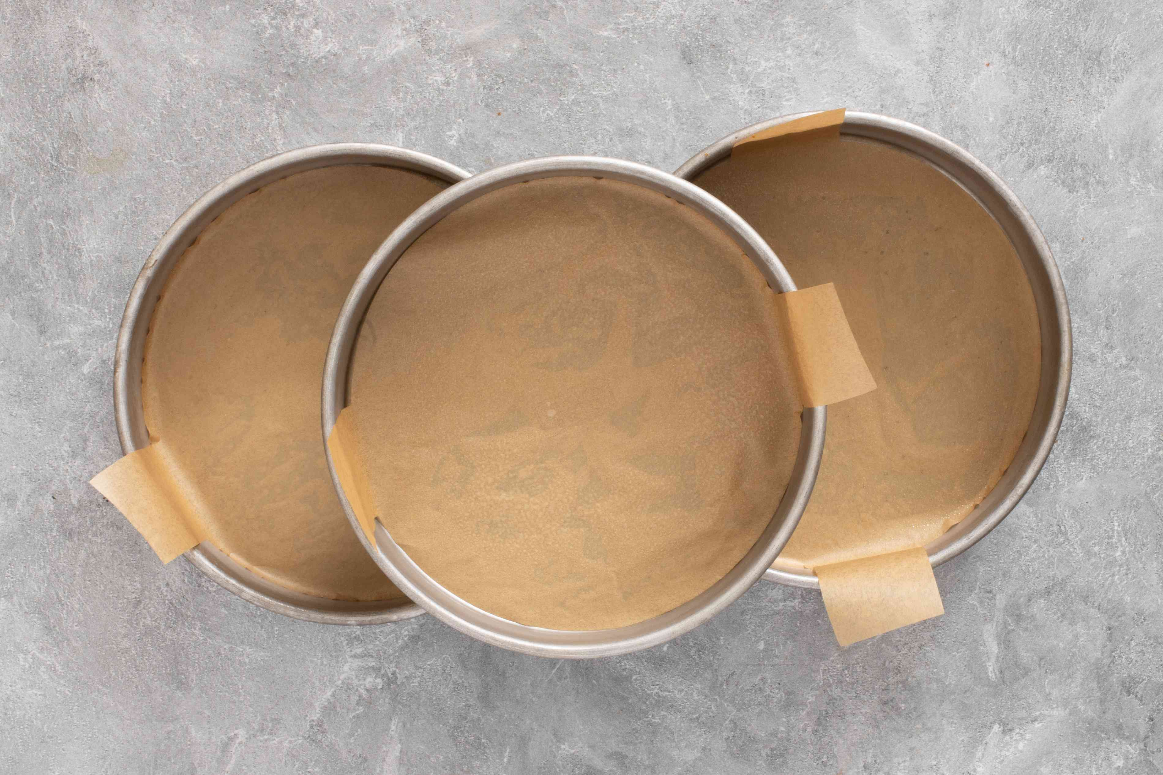 cake pans lined with parchment paper