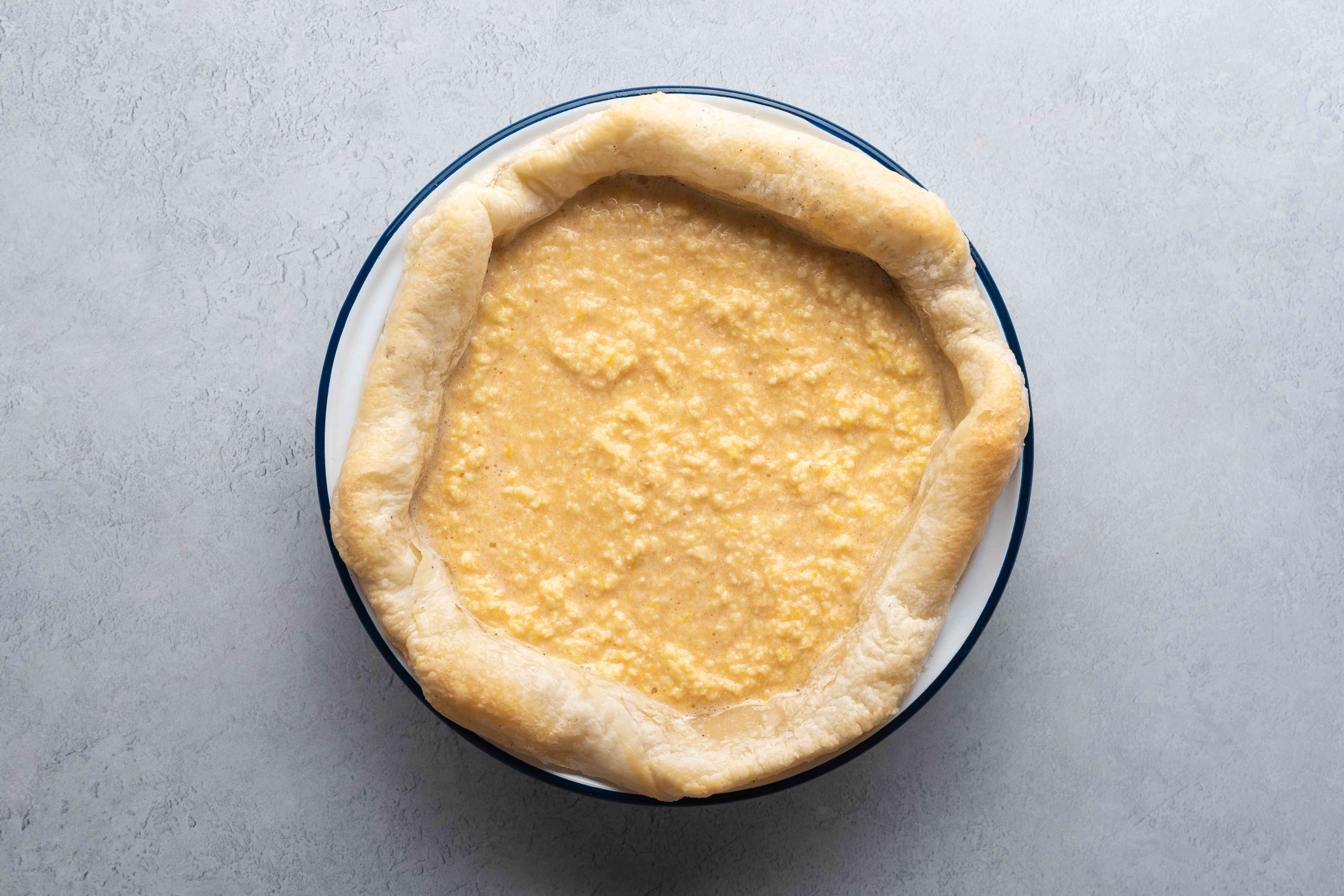 Pour the mixture into the pastry