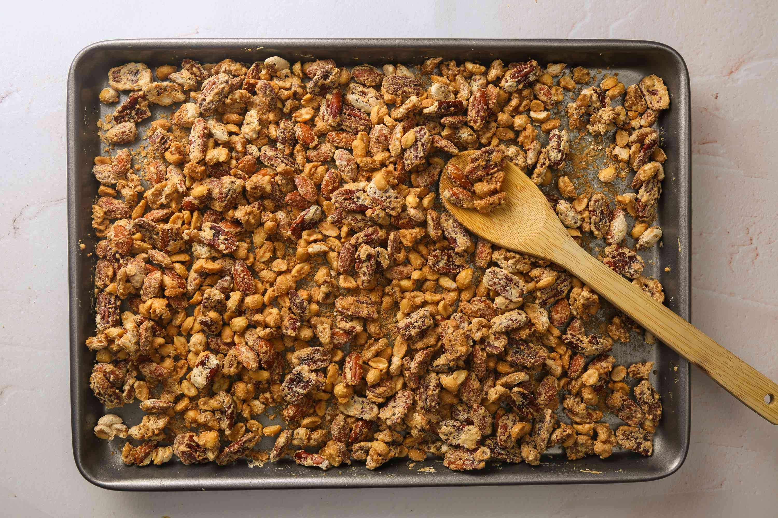 baked nuts on a baking sheet