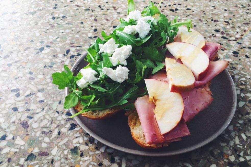 Goat Cheese, Rosemary Ham, Apple, and Honey Sandwich With Arugula