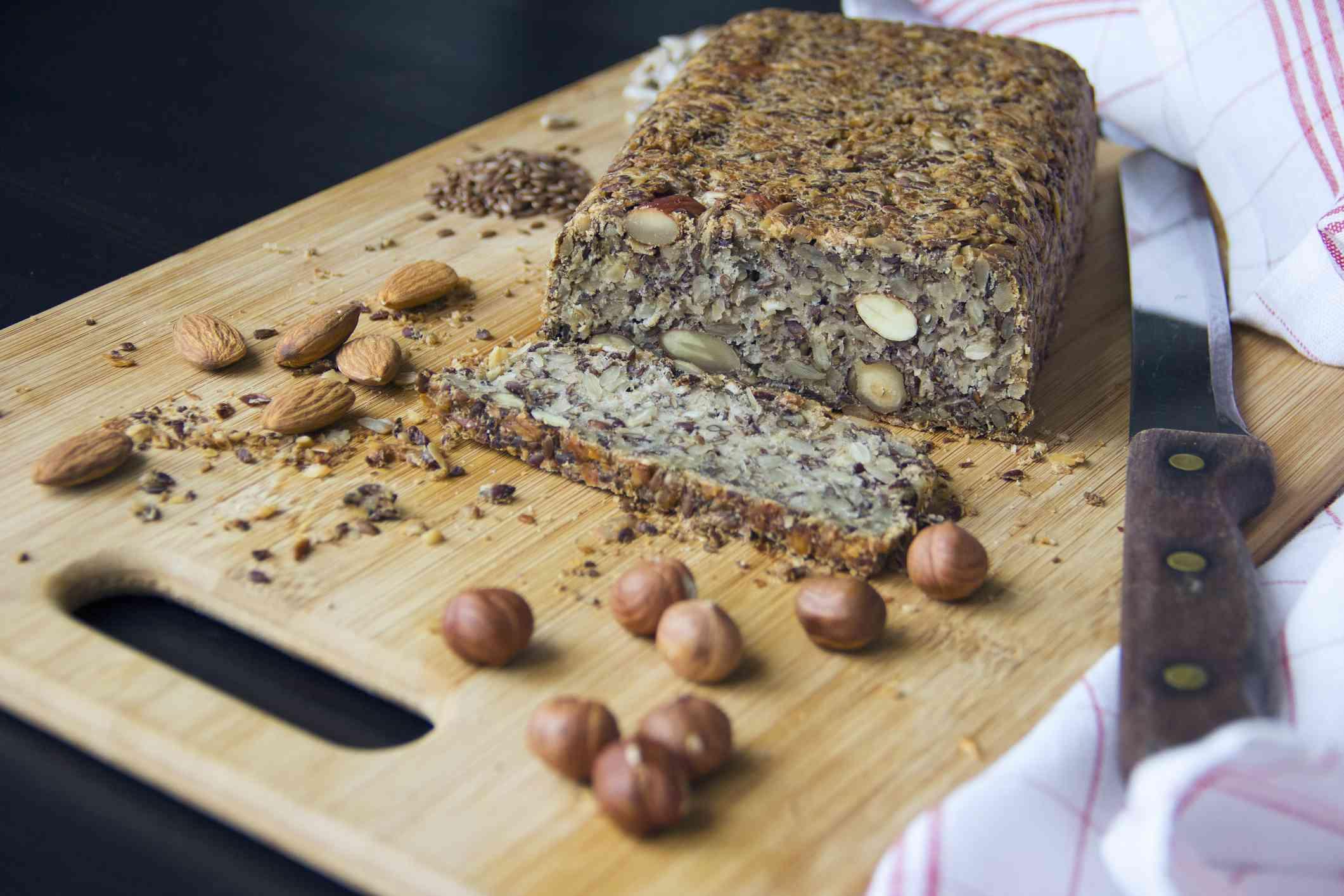 Fresh homemade keto bread with almonds, hazelnuts, sunflower seeds, chia seeds