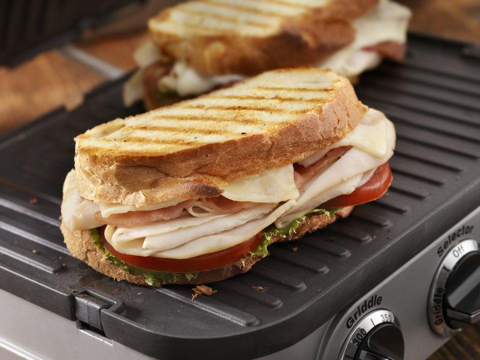 Turkey Club Panini on grill press