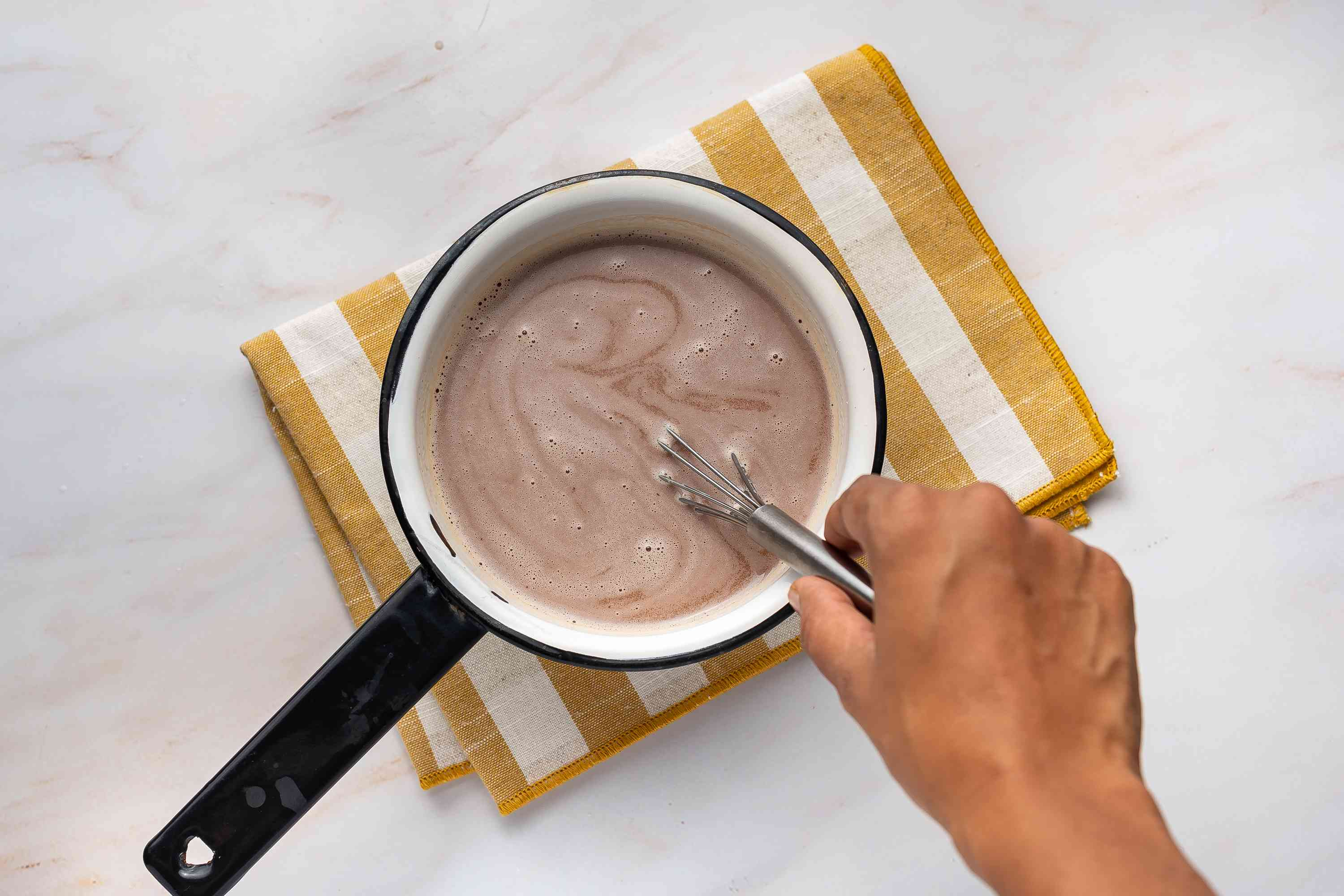 Chocolate added to the milk mixture in the saucepan
