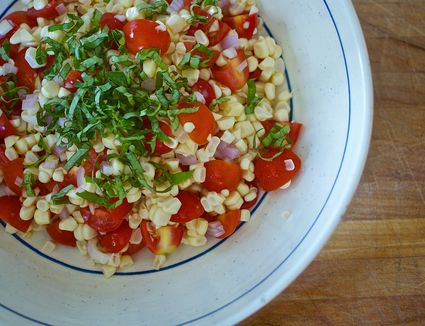 A corn tomato and basil salad