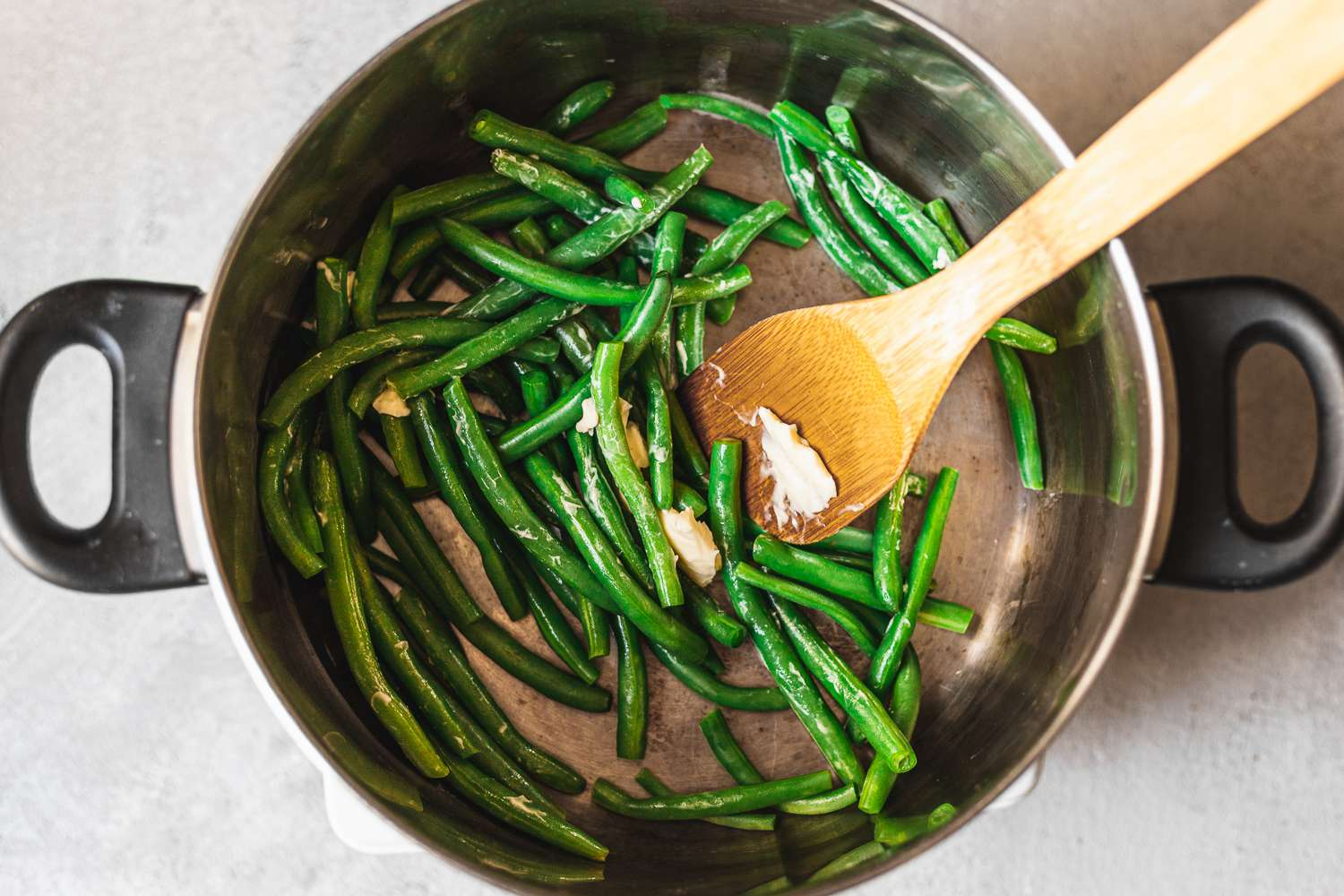 Green beans in pot with butter