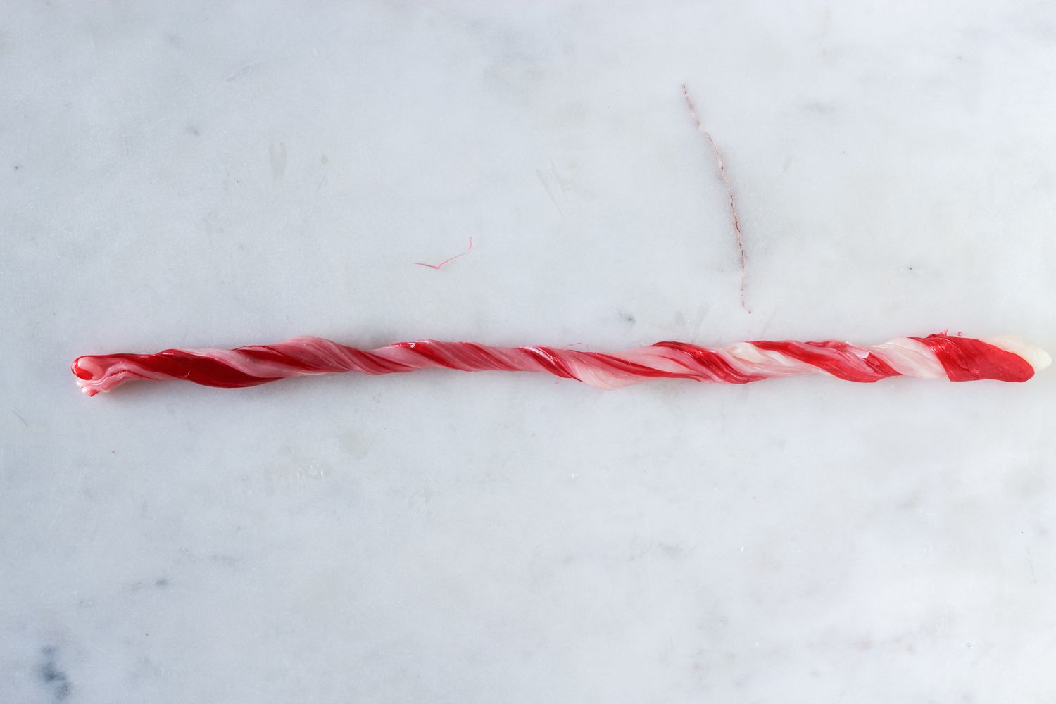 Twist and stretch the candy into a longer rope