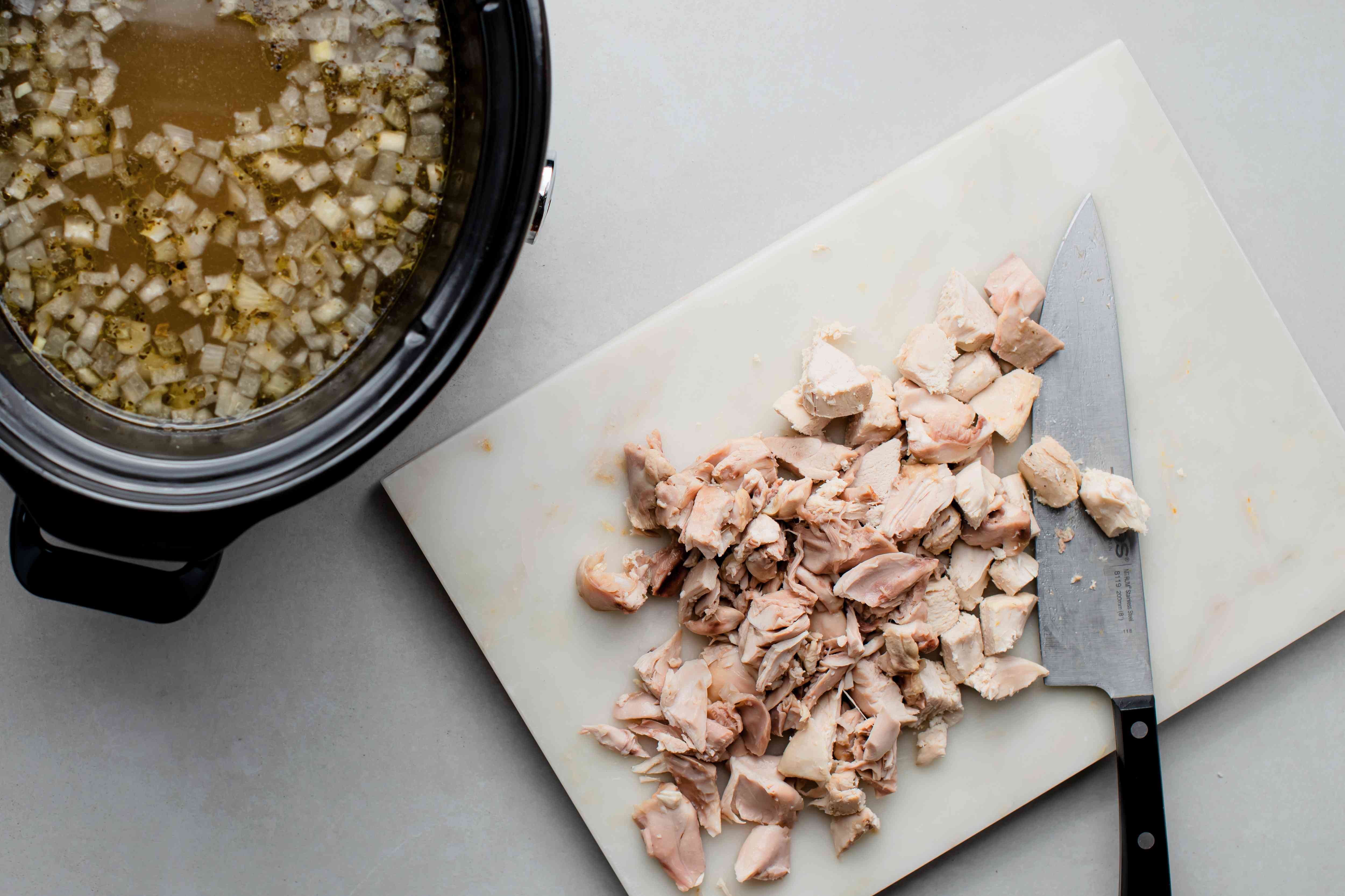 diced chicken on a cutting board