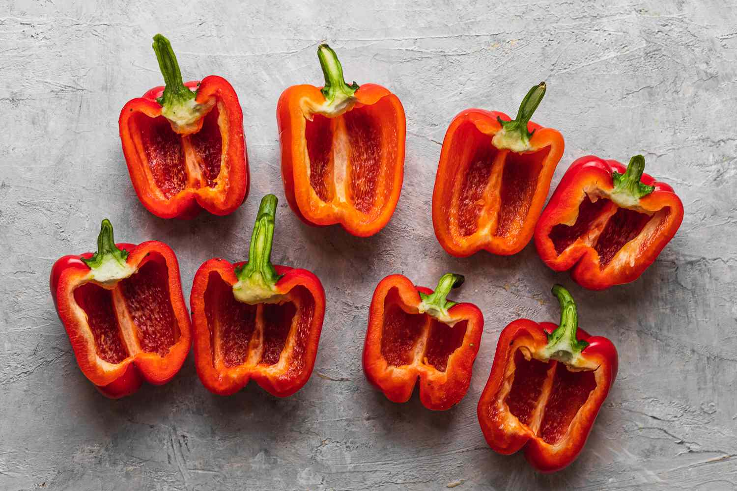 red bells peppers cut lengthwise with the seeds and membranes removed