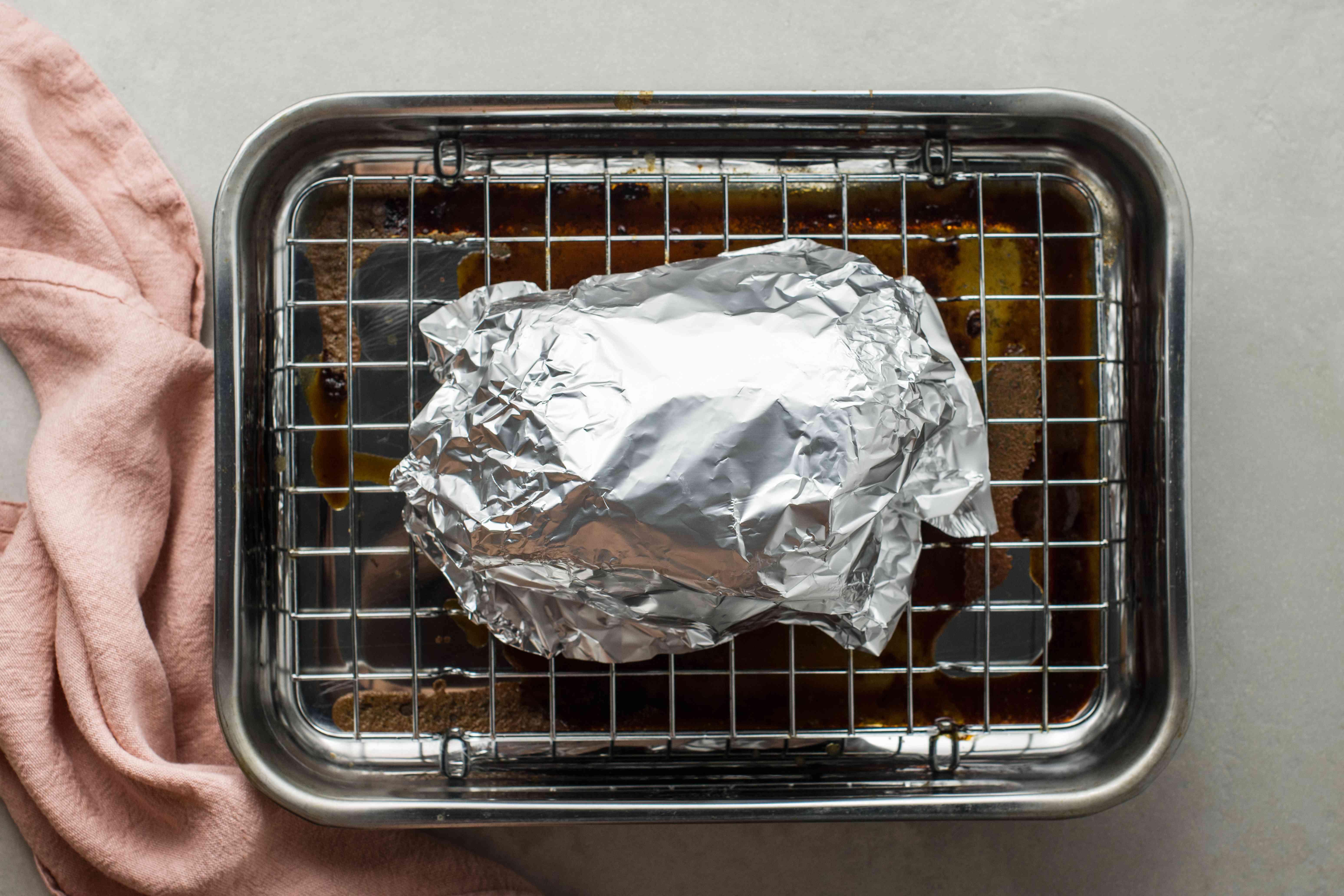 Roast resting under aluminum foil