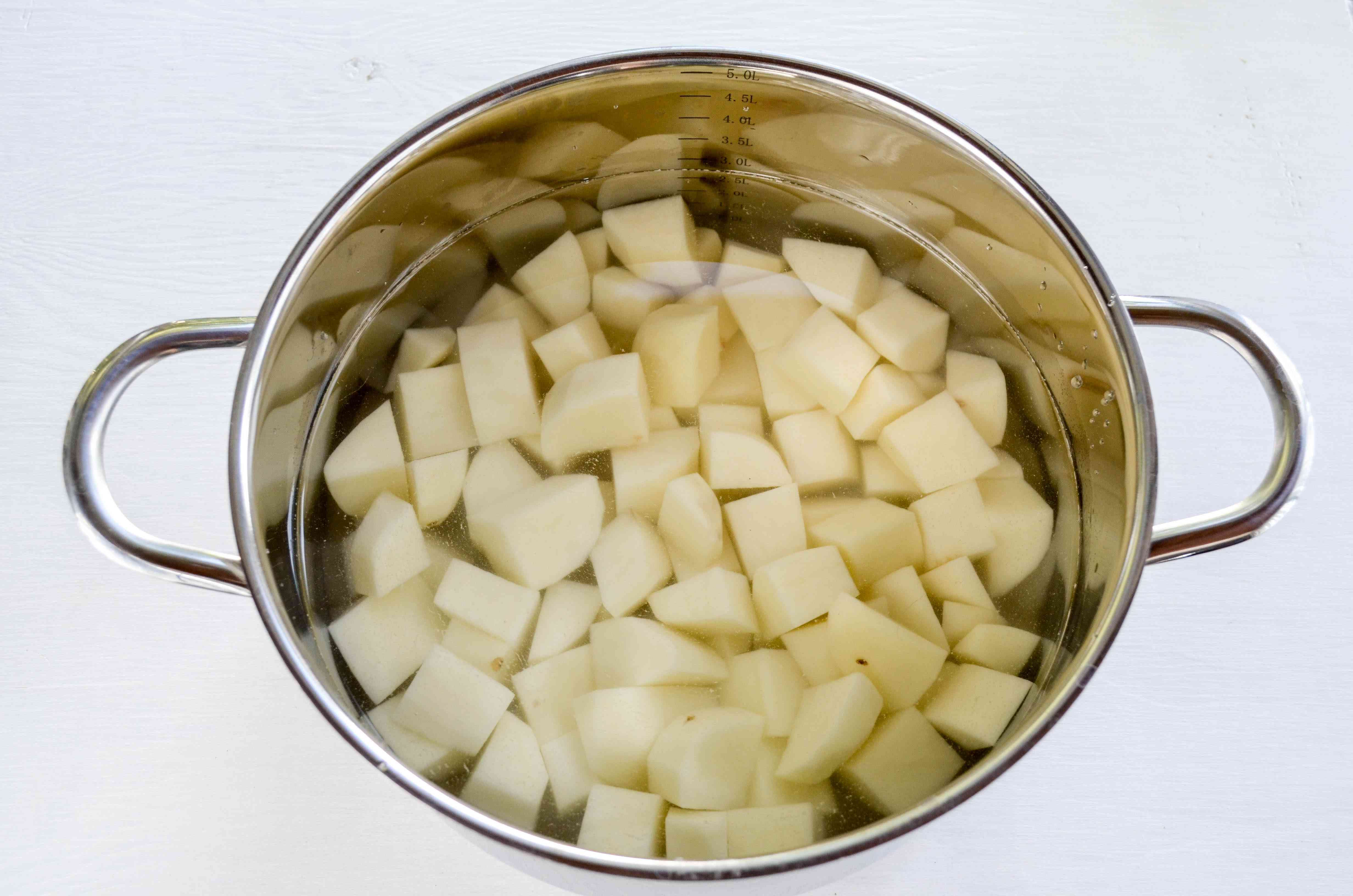 Cover the potatoes with water