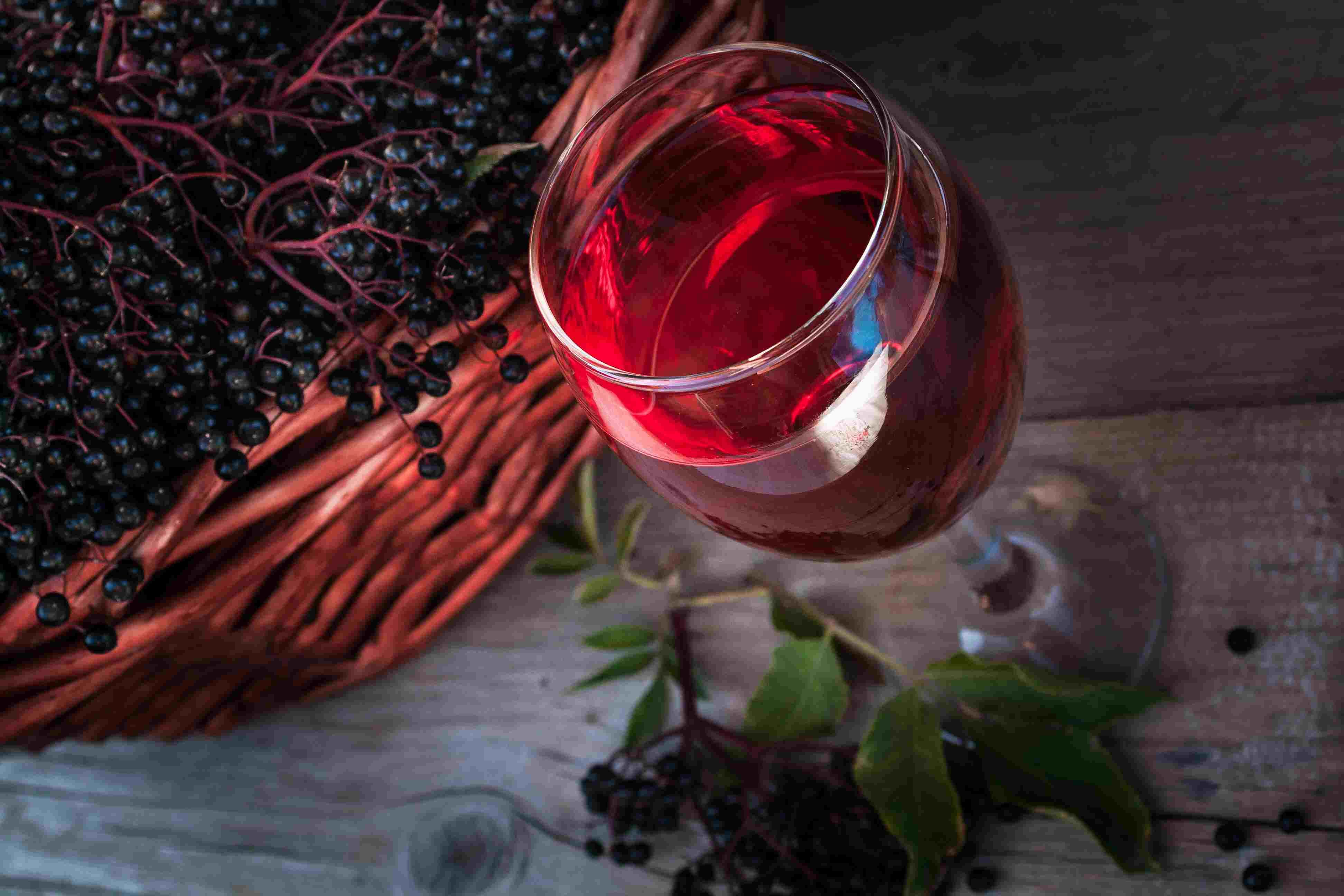 Elderberries and a glass of elderberry wine