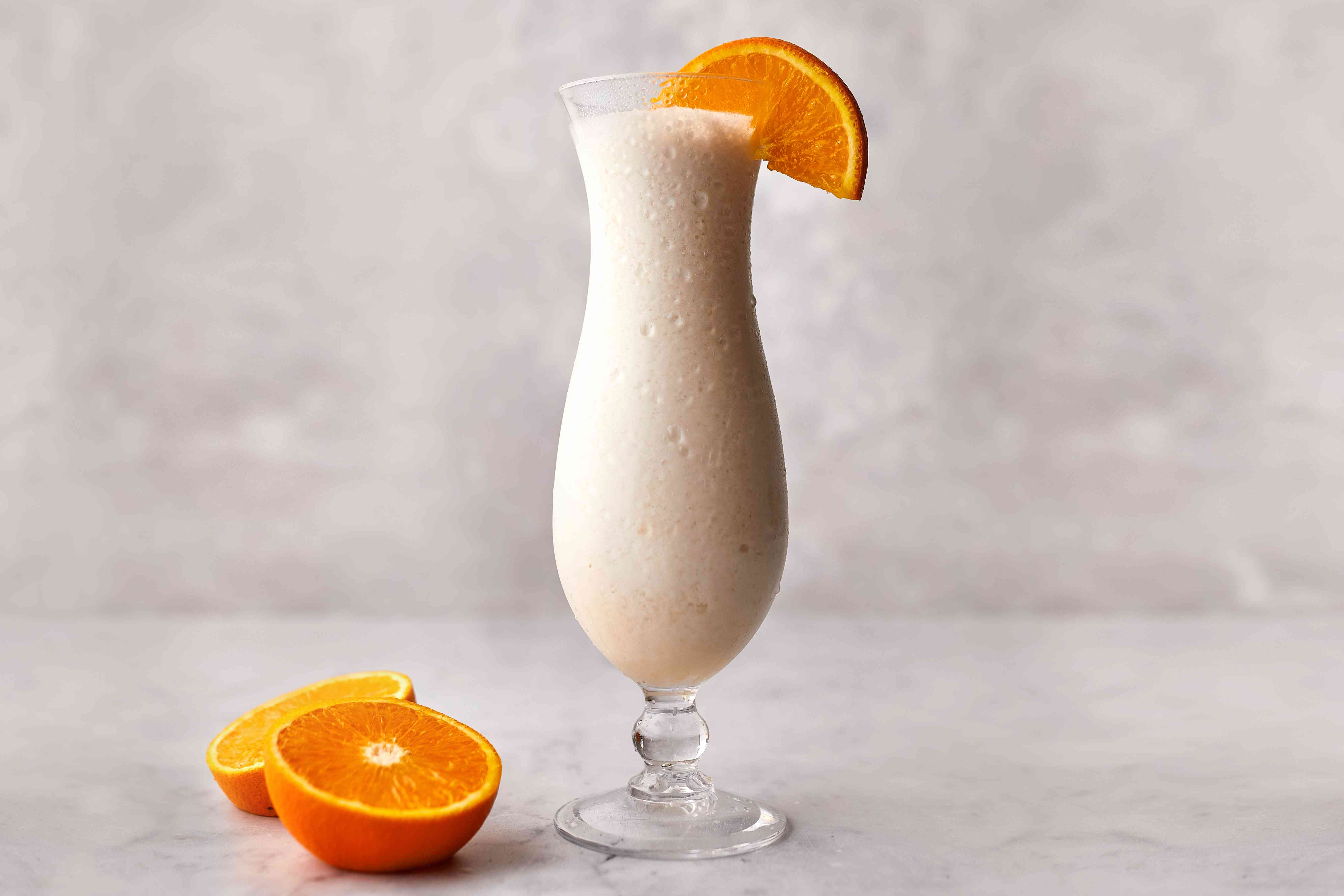 Virgin Pina Colada in a chilled hurricane glass and garnished with an orange slice