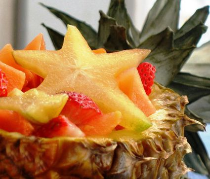 Tropical fruit salad served in a pineapple