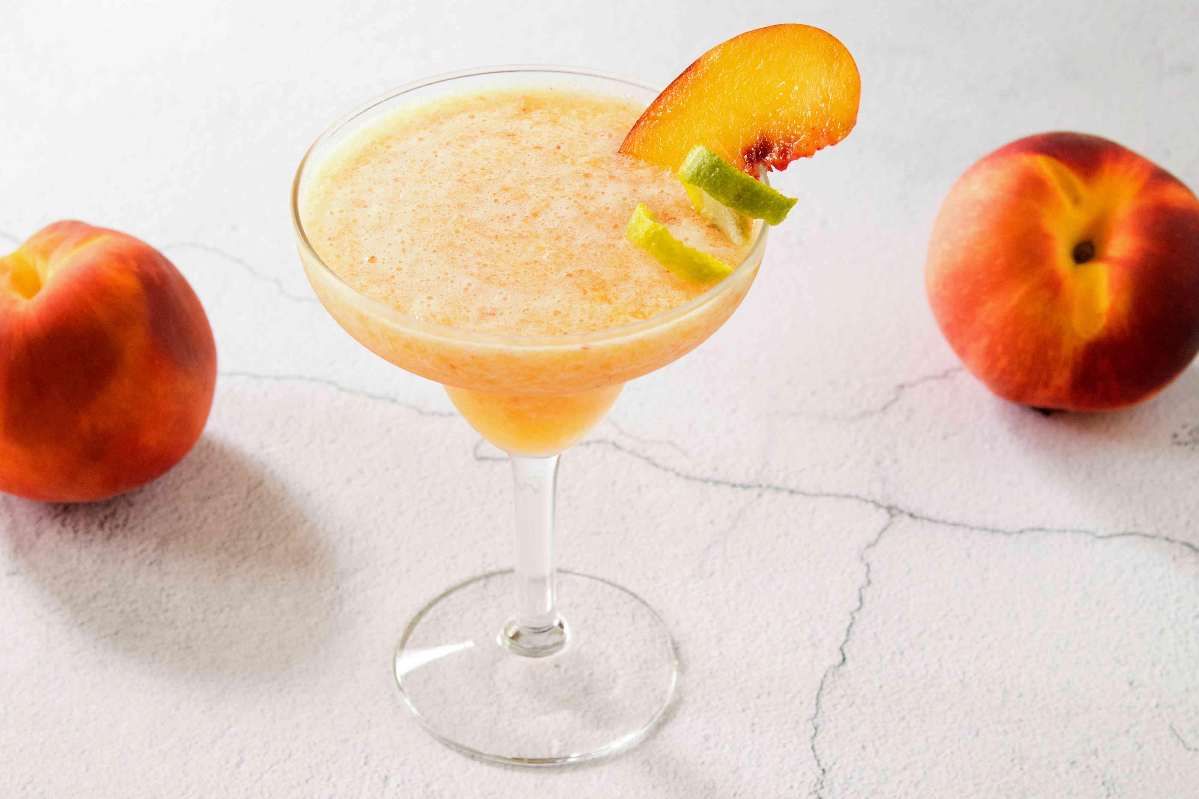 Frozen Peach Margarita with garnishes