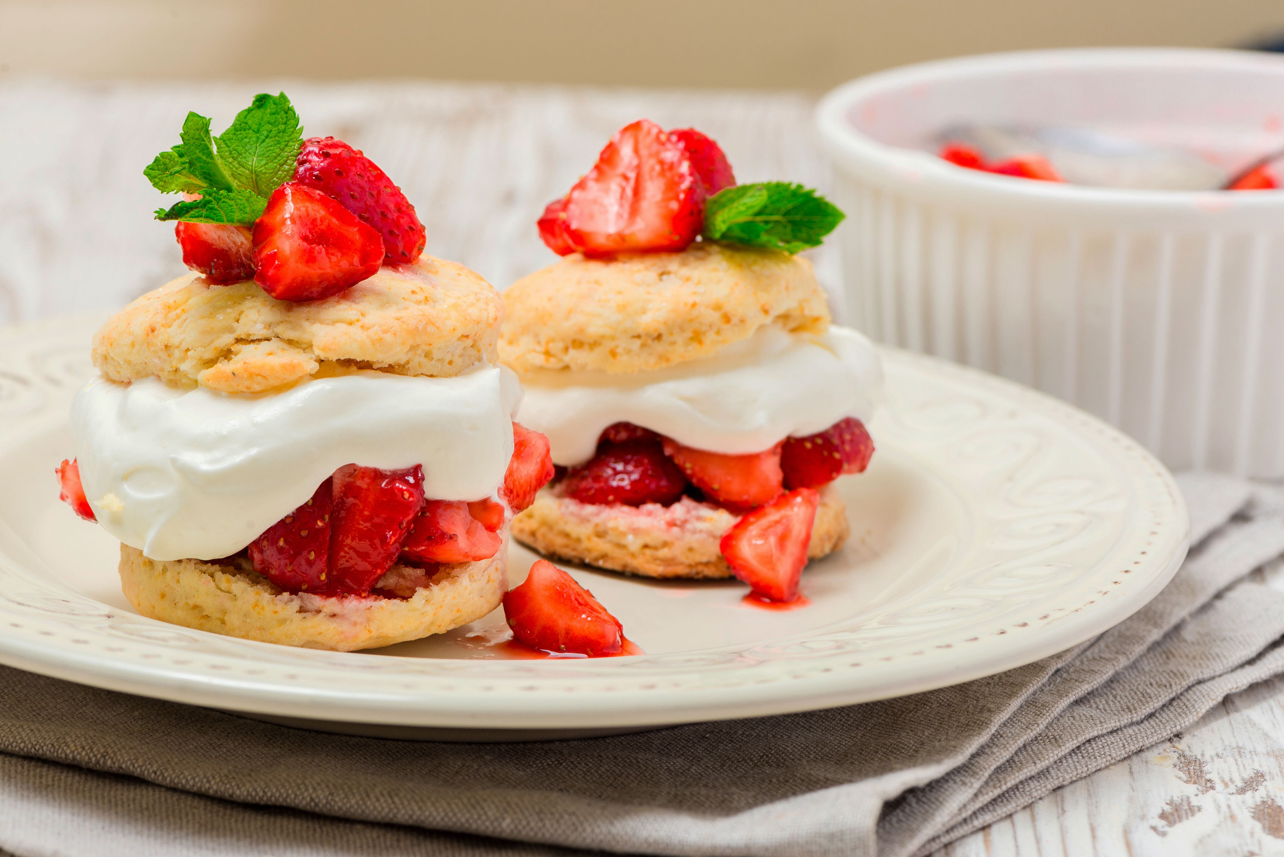 Add strawberries and whipped cream to biscuits to make shortcakes