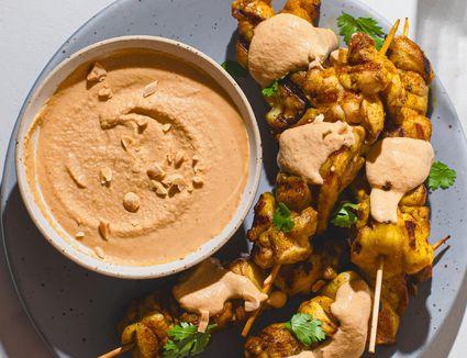 Satay peanut sauce alongside chicken satay