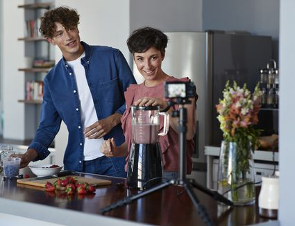 couple filming blender