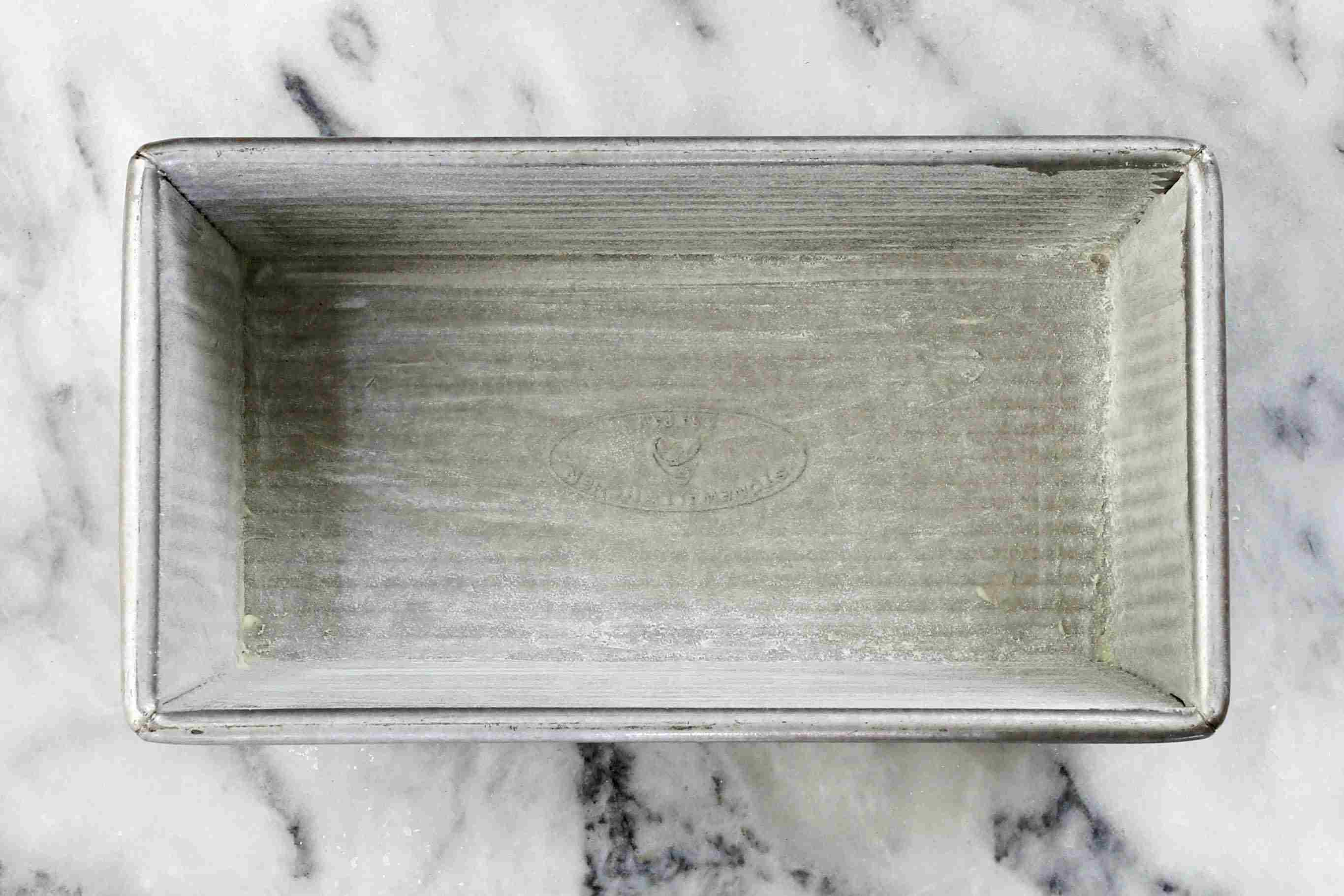 Grease and flour the loaf pan.