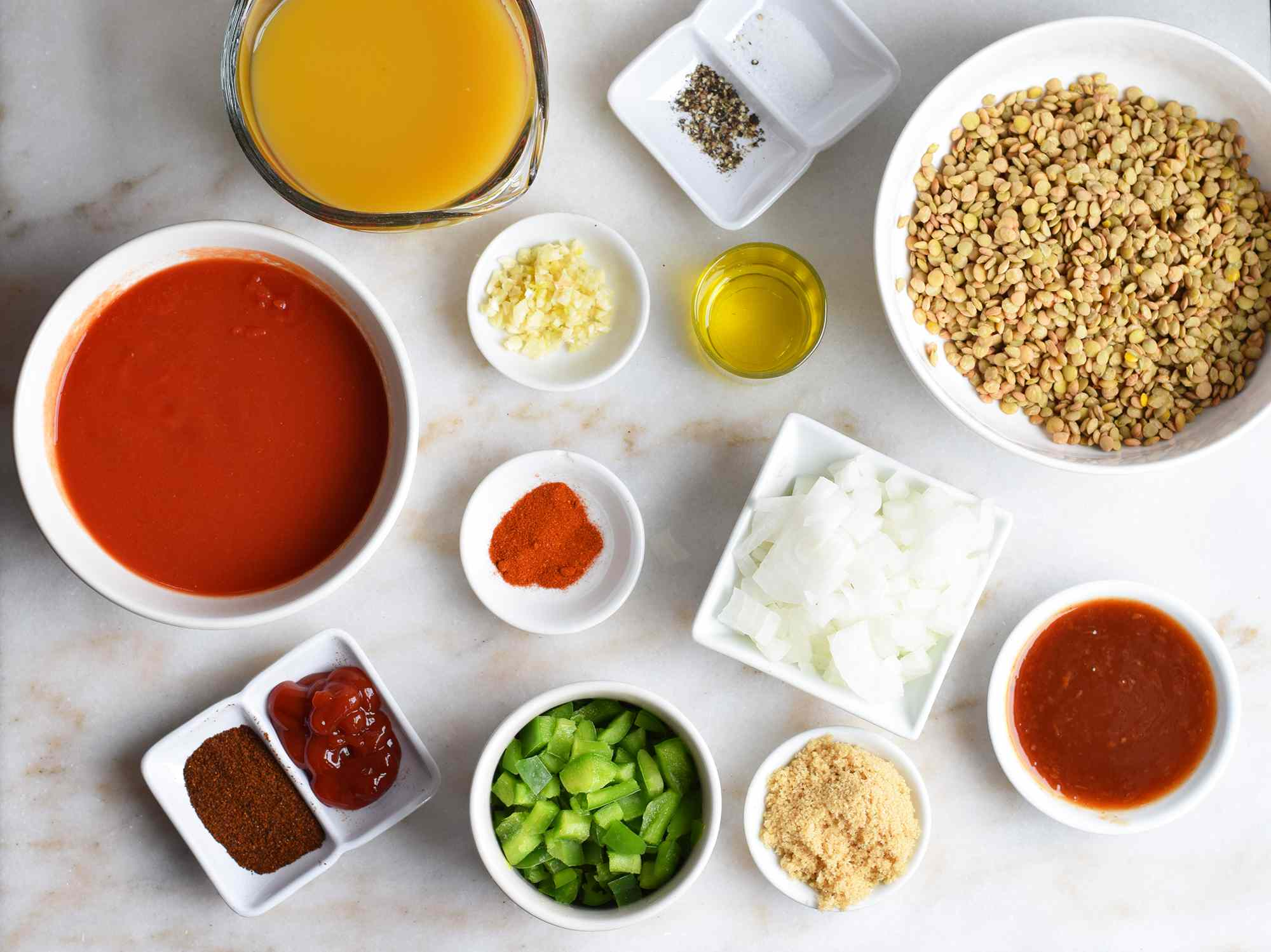ingredients for lentil sloppy joes on a marble board