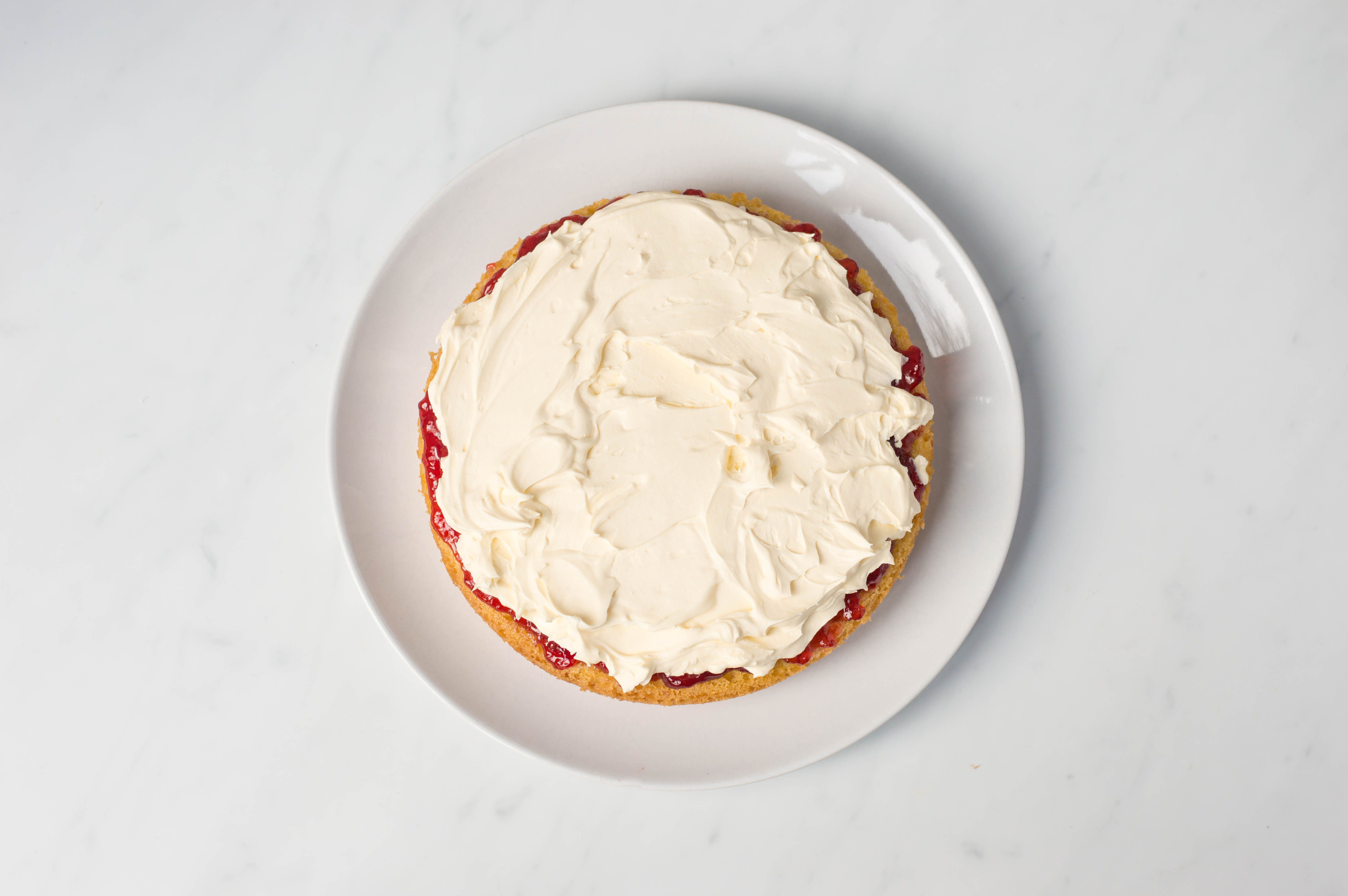 Add a layer of whipped cream to the cake