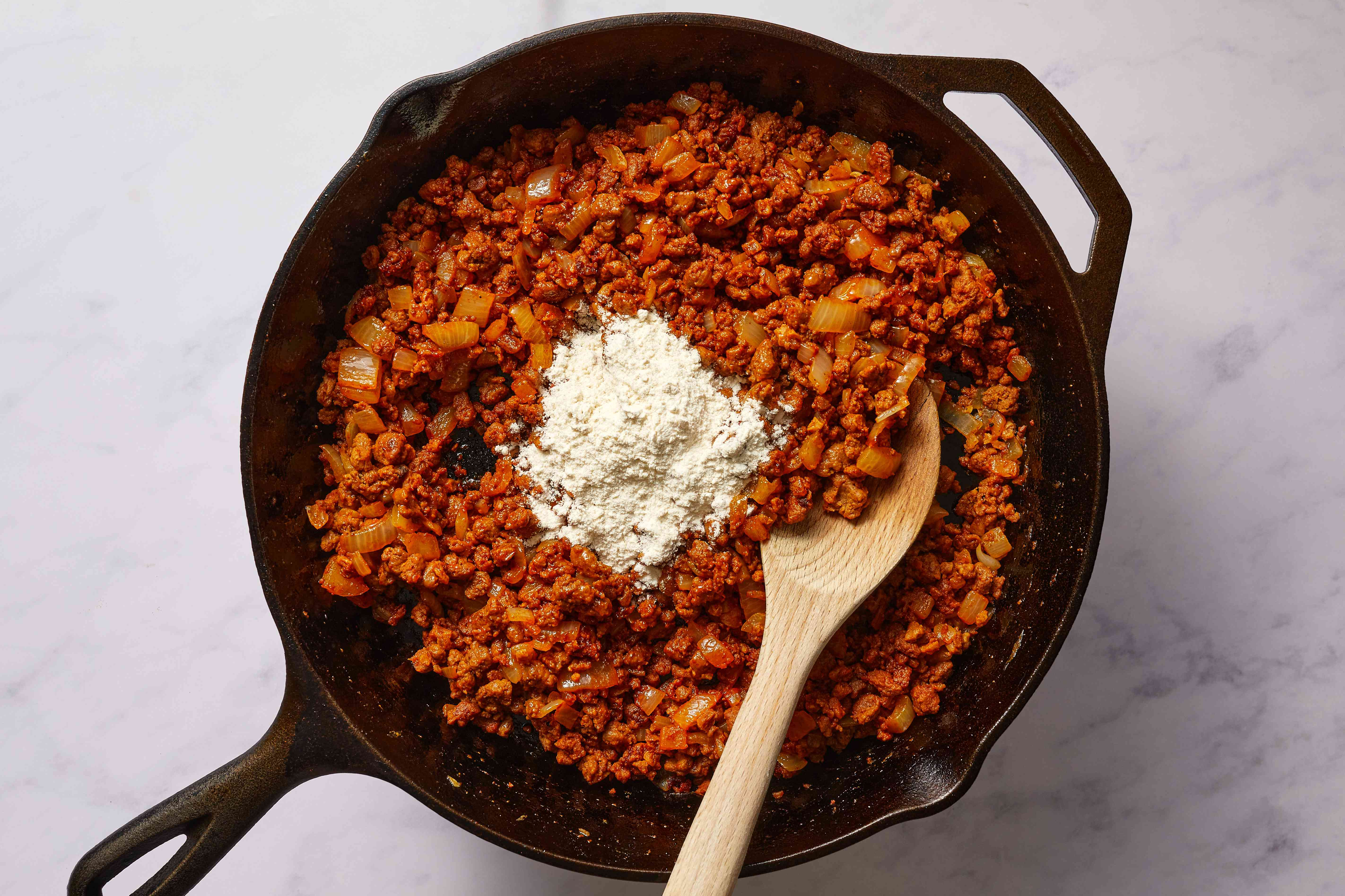 flour added to the meat mixture in the skillet