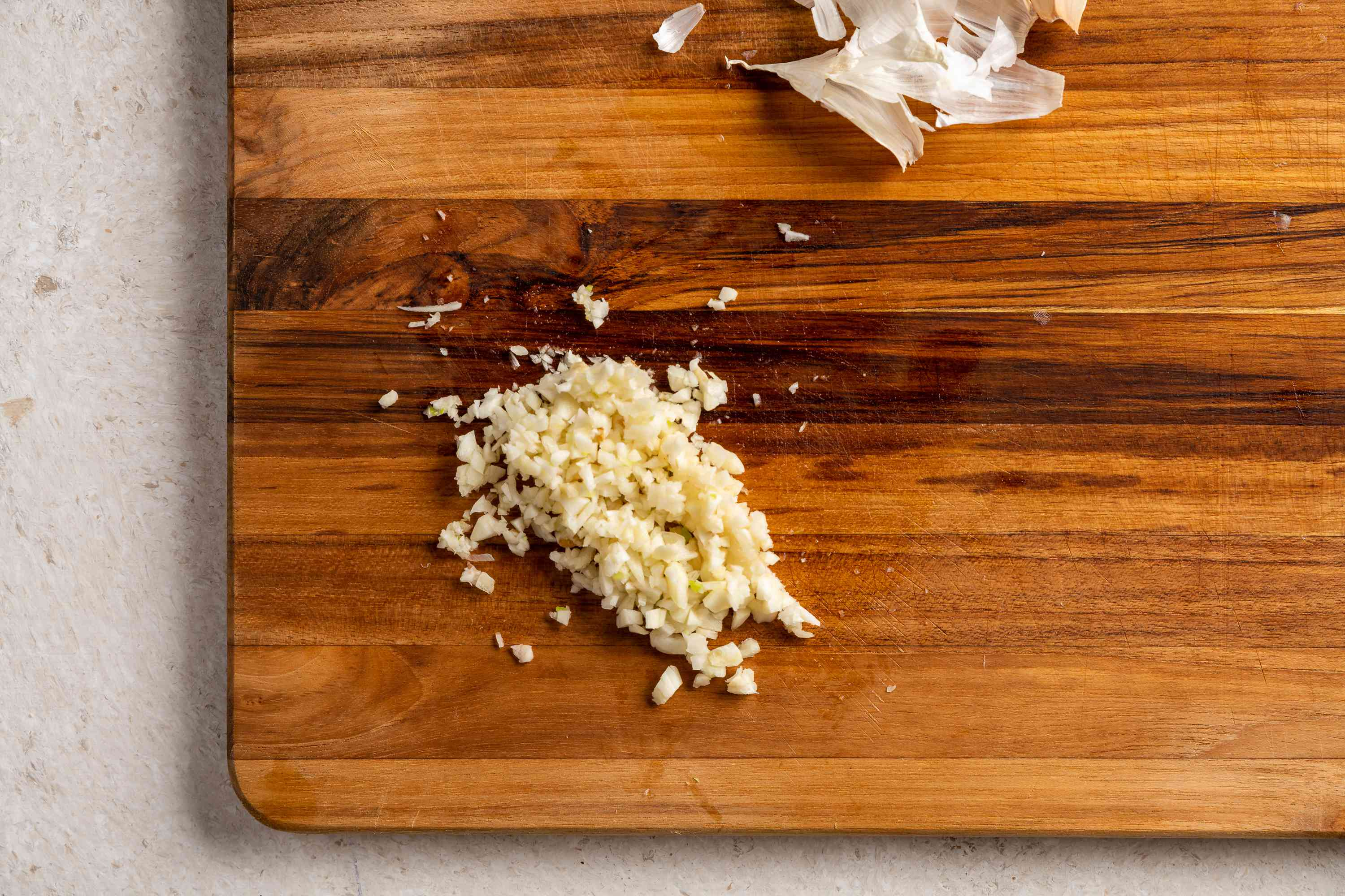 Crush, peel, and finely mince the garlic