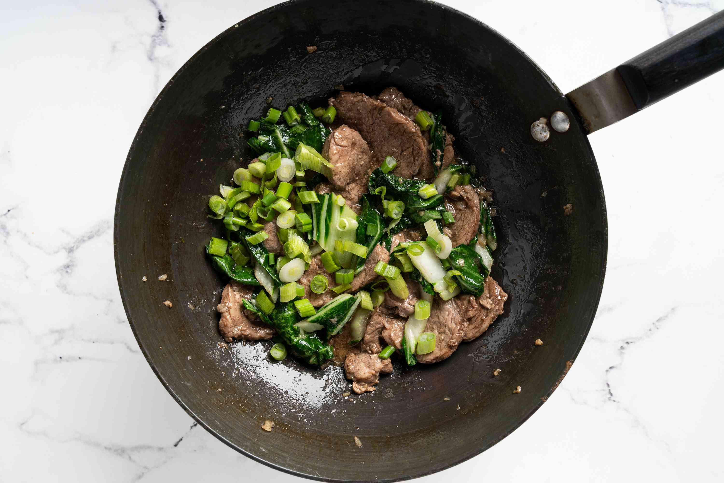 Five-Spice Pork with Bok Choy and Green Onions in a pan