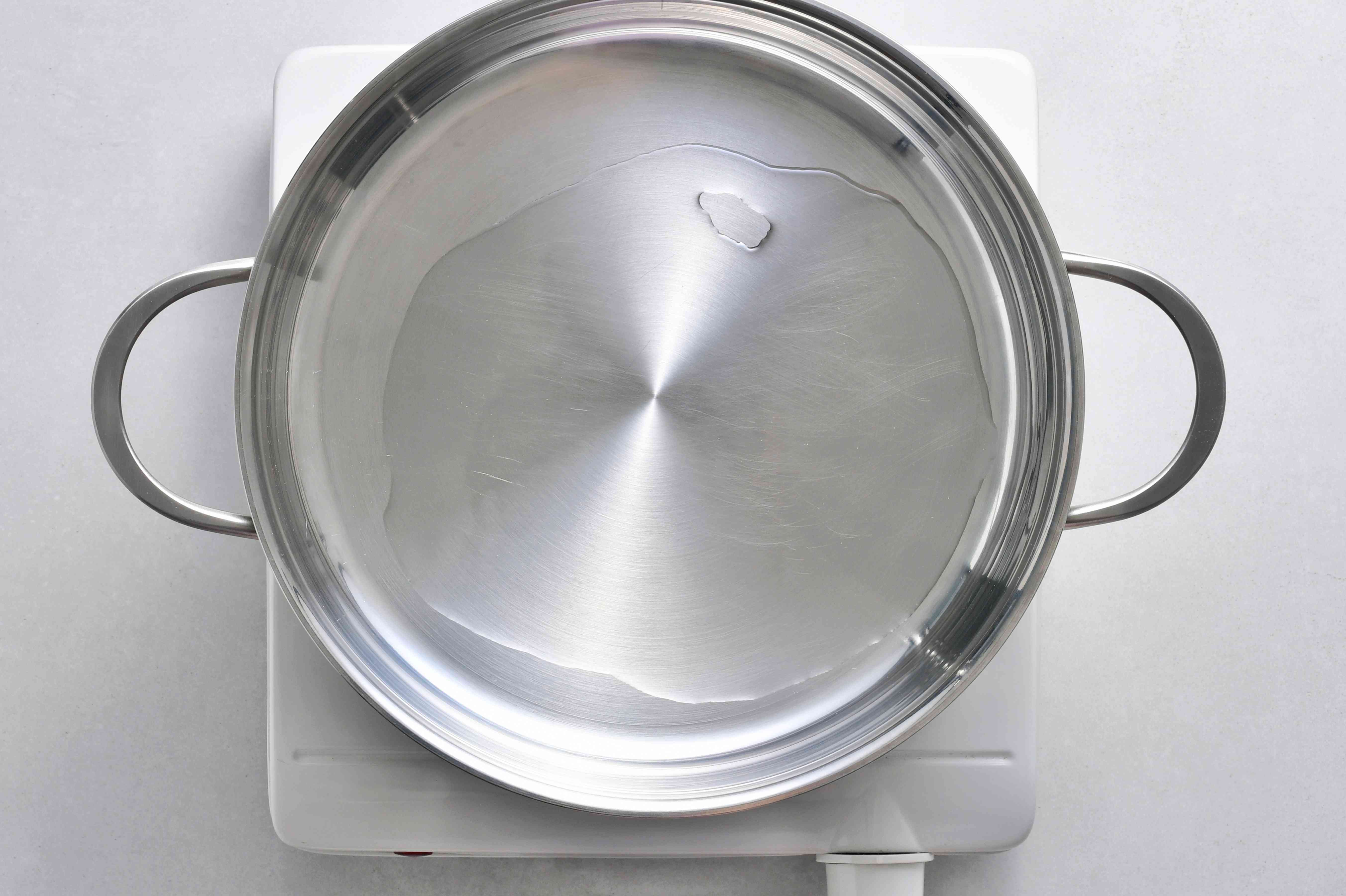 Heat vegetable oil in a pot